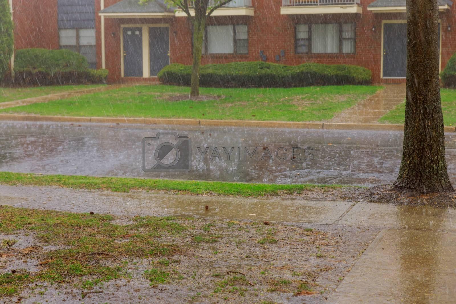 Rainy season on apartment building during strong winds heavy rain drops falling on asphalt