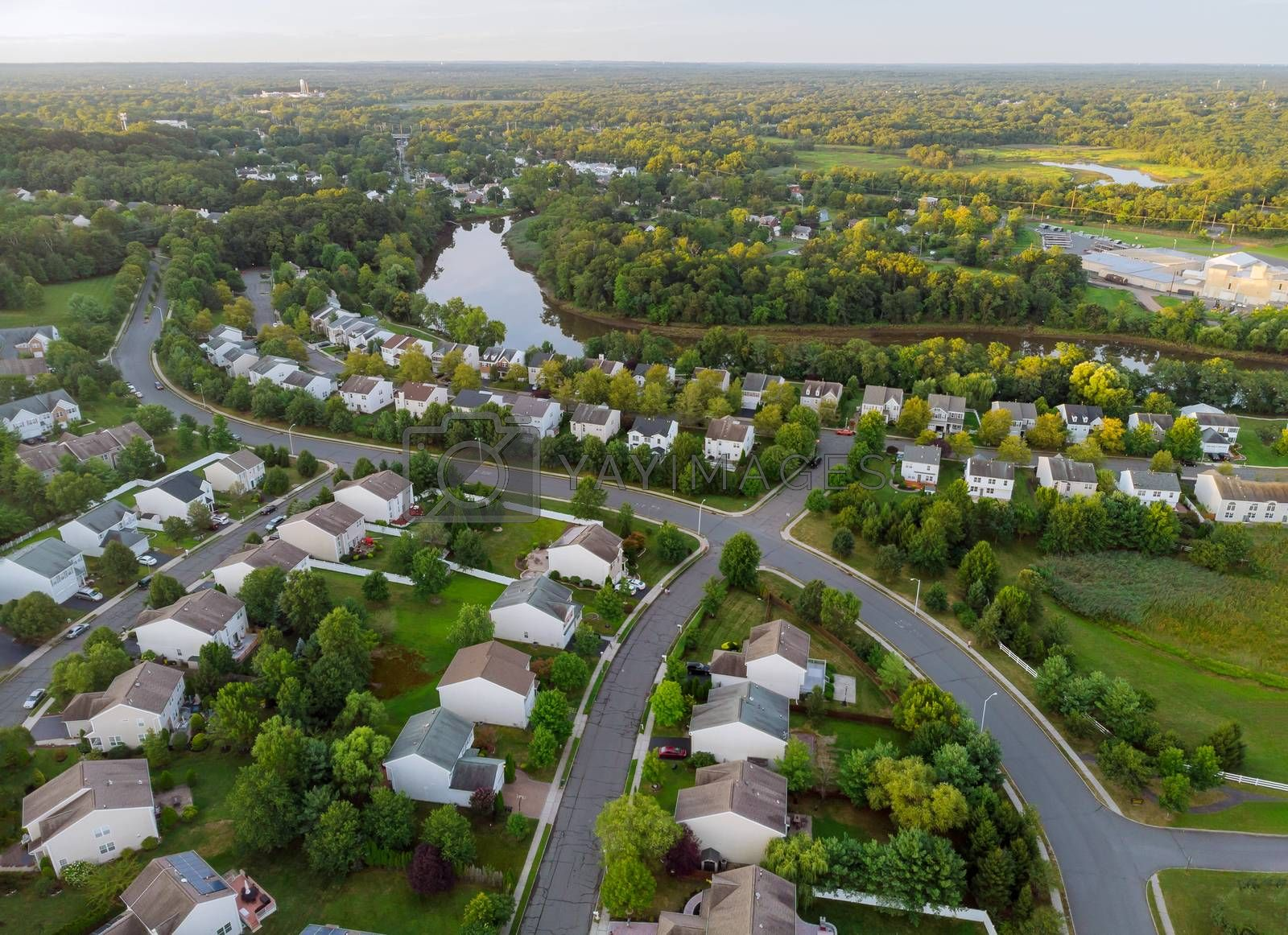 Landscape scenic aerial view of a suburban settlement in USA with detached houses