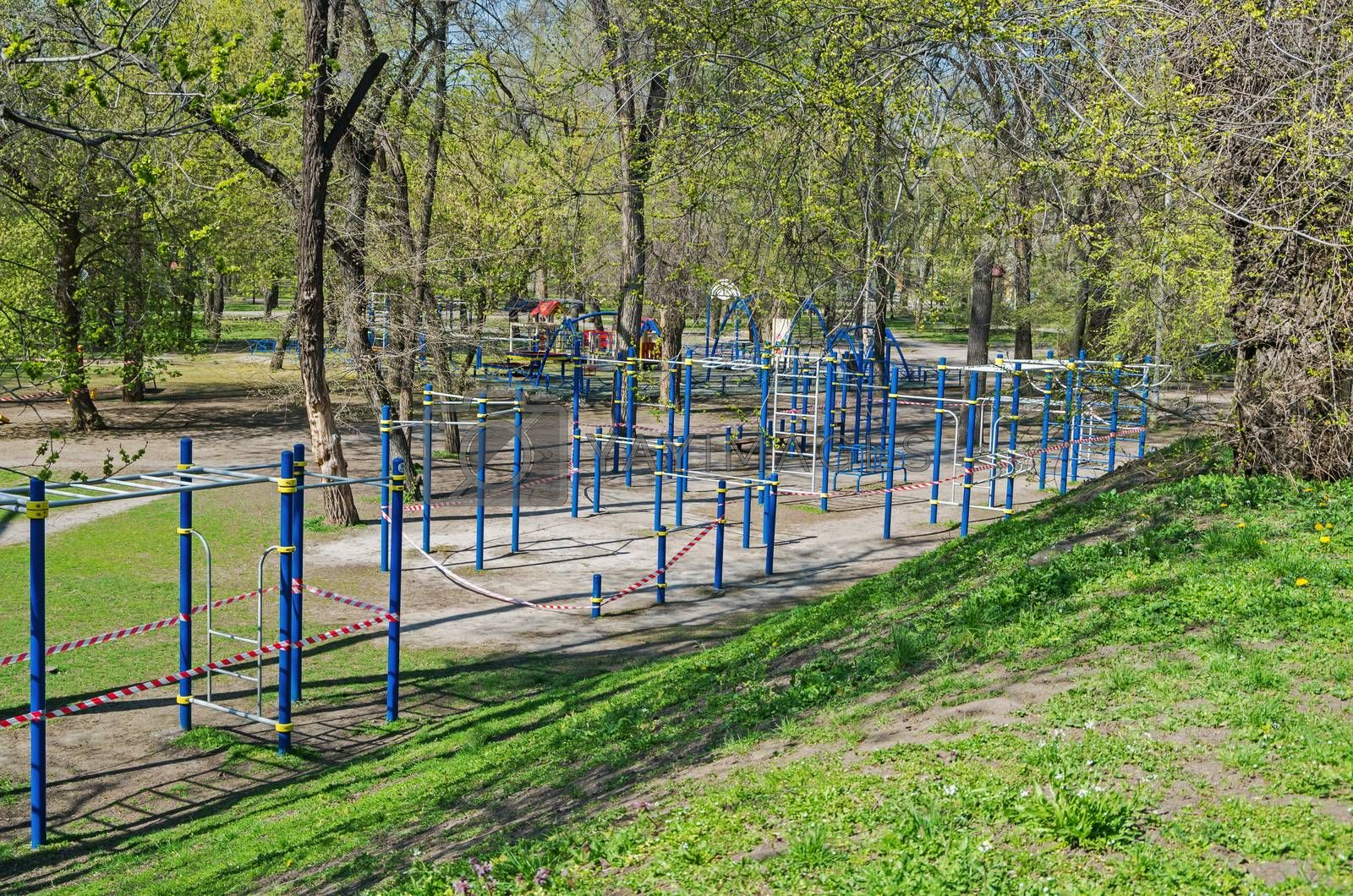 Sports playground in old city park is fenced with barricade tape during COVID-19 coronavirus infection pandemic. It is forbidden to be in public places during quarantine