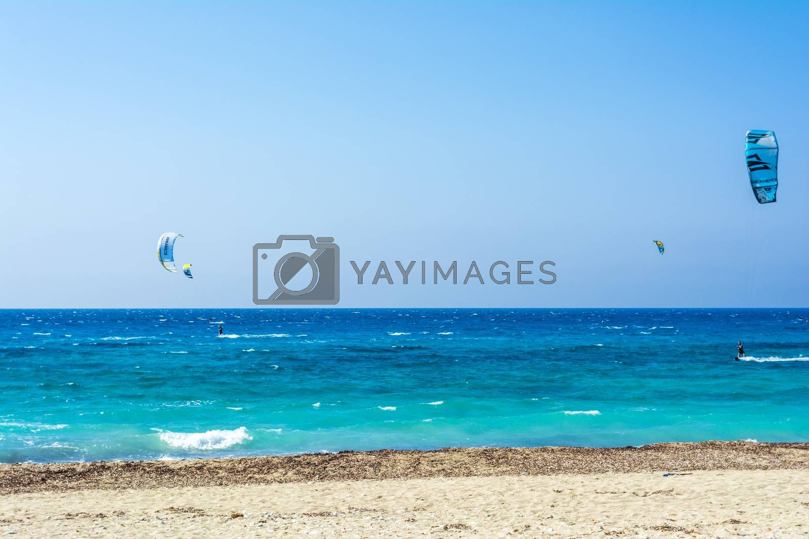 Agios Ioannis beach in Lefkas island Greece. Colorful power kites span across the sky from kite-surfers.