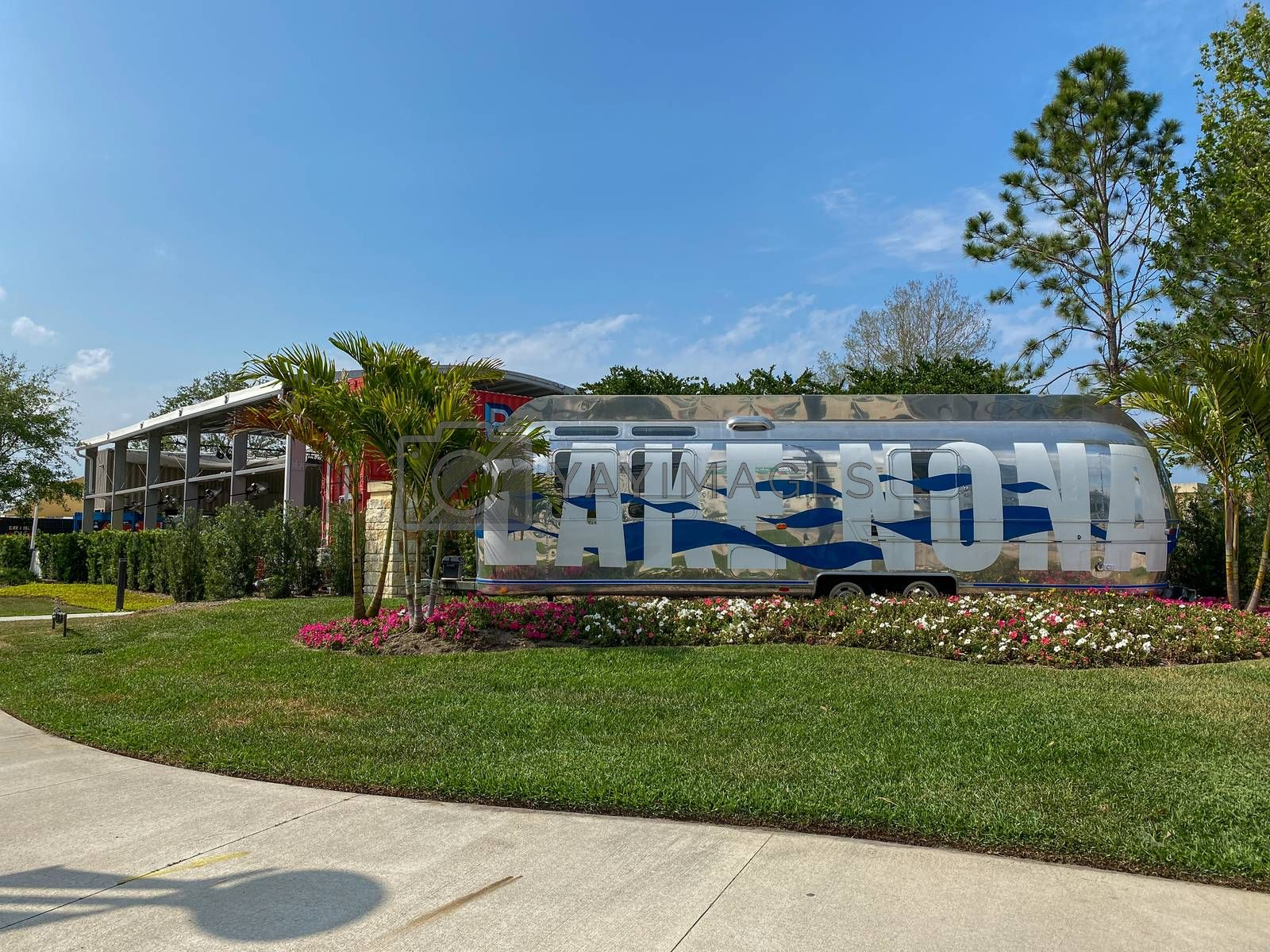 Orlando, FL/USA-4/10/20:  An Airstream Trailer that is painted with the words Lake Nona is the entrance to the Town Center at Lake Nona in Orlando, Florida.