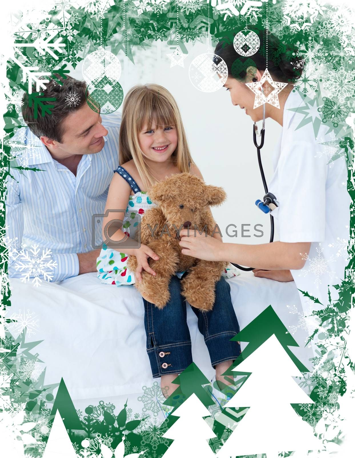 Female doctor and happy little girl examing a teddy bear against christmas themed frame
