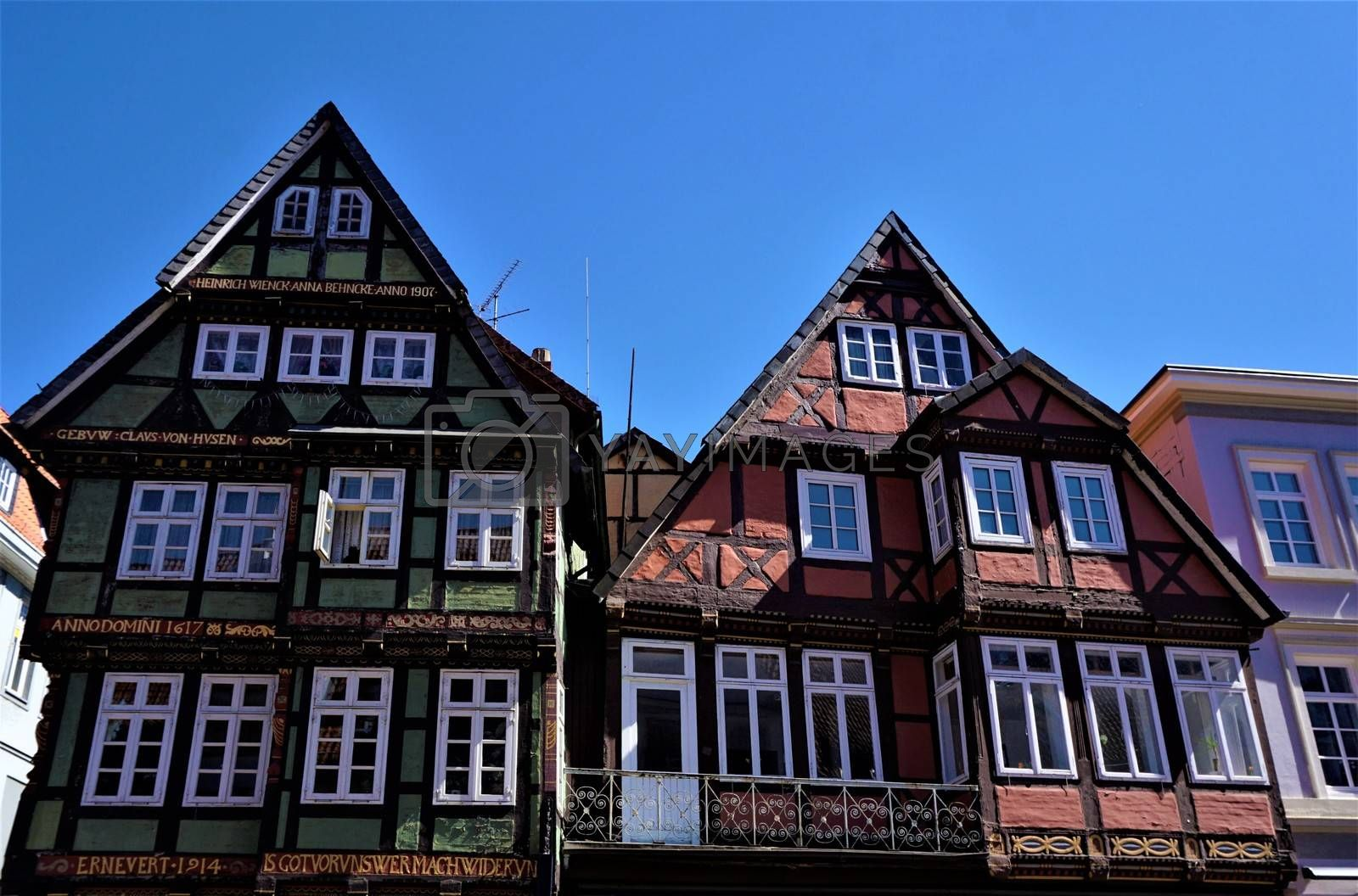 Green and pink half-timbered house in the old town of Celle, Germany