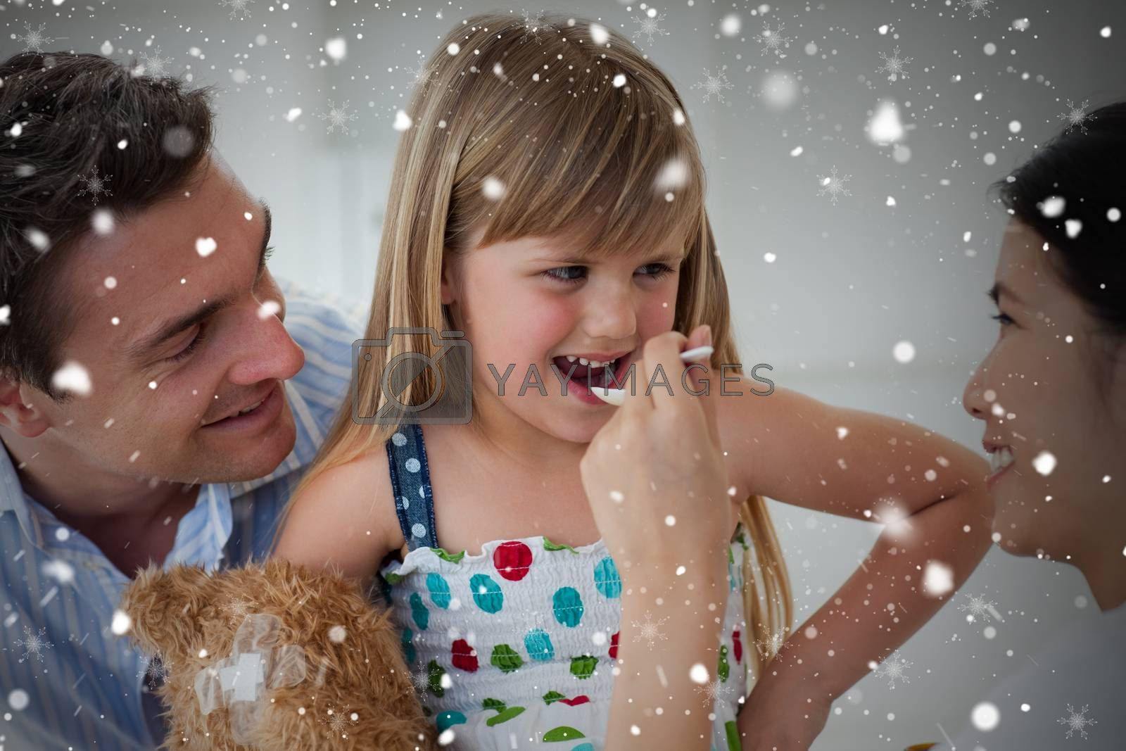 Composite image of smiling doctor giving medicine to a child against snow falling