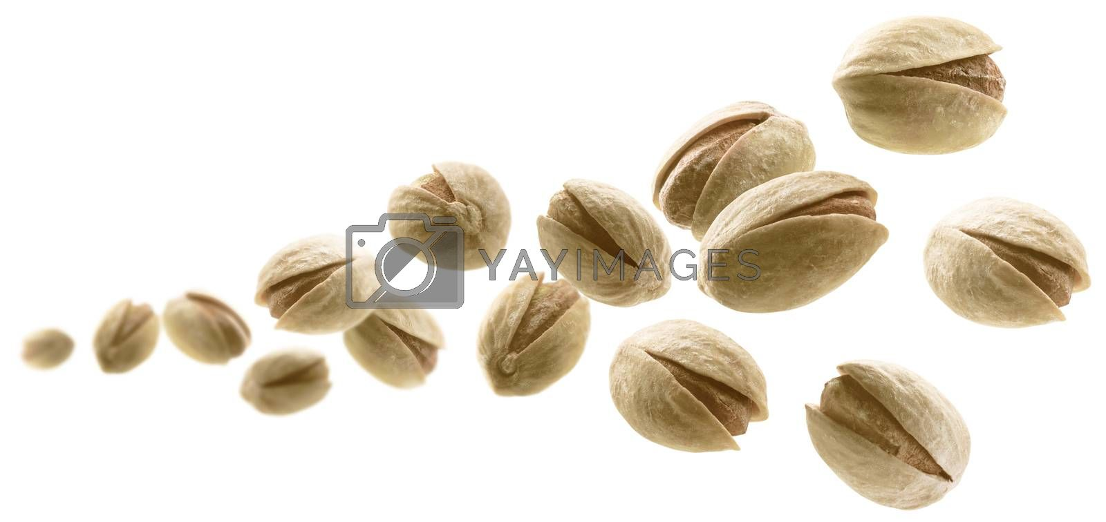 Salted pistachios levitate on a white background.