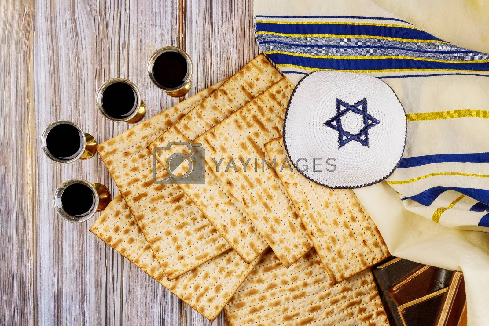 Red kosher four glasses wine with a of matzah a Passover Haggadah on a vintage wood background