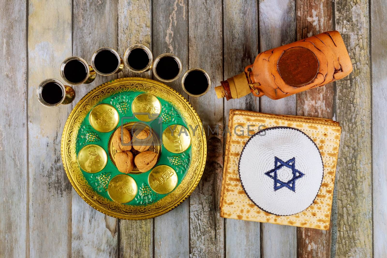 Passover Jewish matzah, kiddush with wine and seder with text in hebrew egg, bone, herbs, karpas, chazeret and charoset.