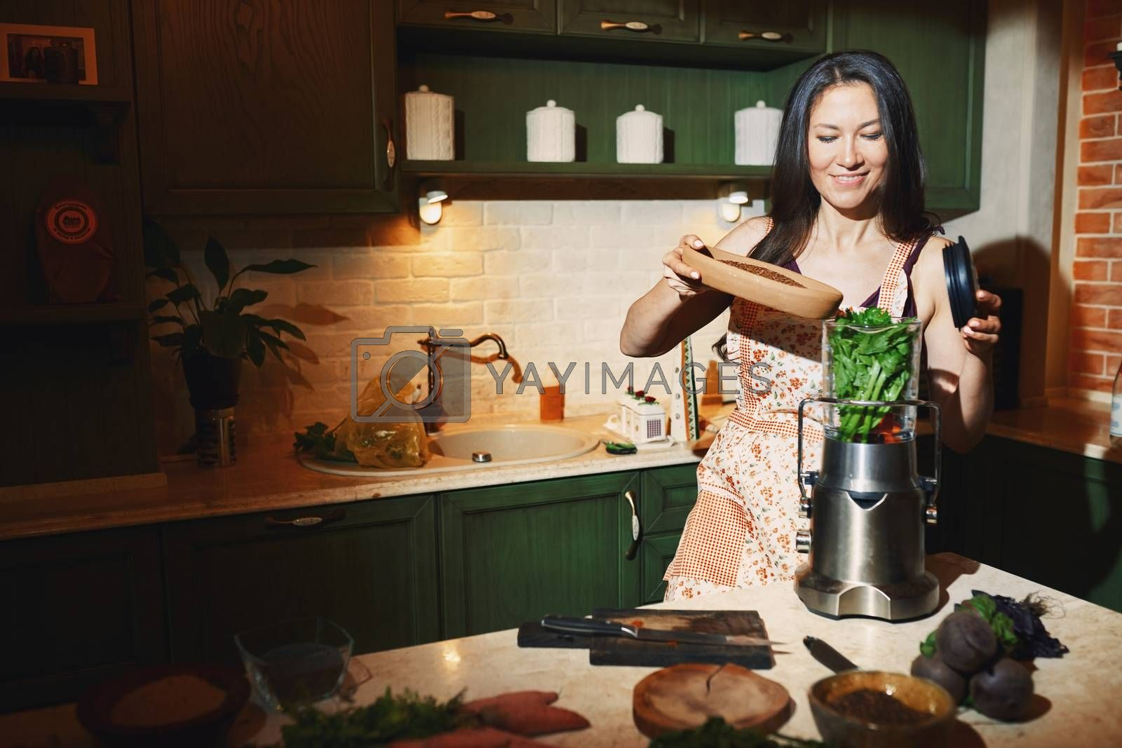 Staying at home woman using mixer for to prepare vegetarian food