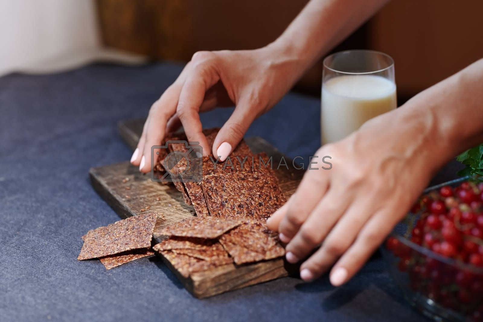Royalty free image of Vegan woman serving flaxseed bread by Novic