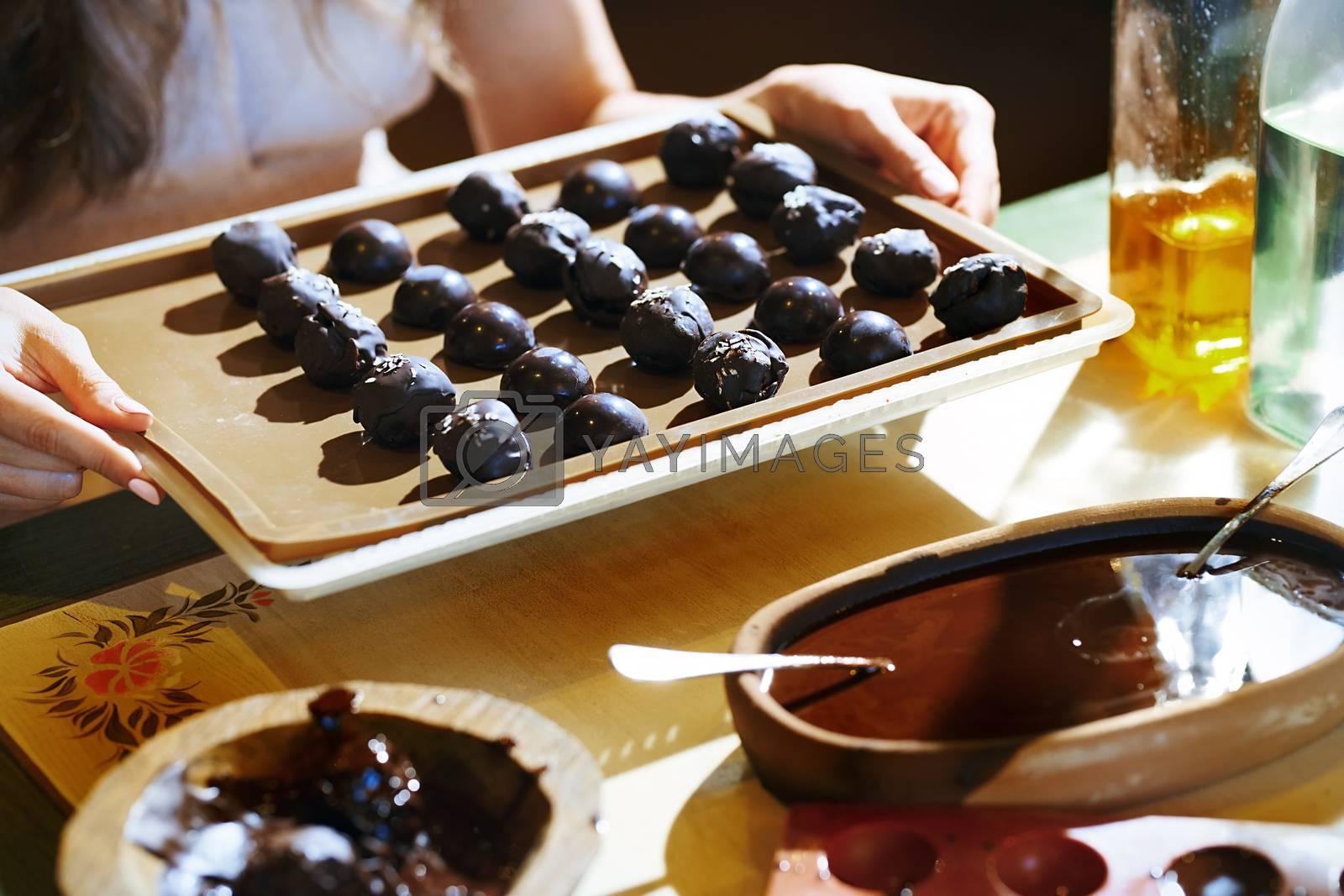 Staying at home woman preparing handmade vegetarian chocolate tr by Novic
