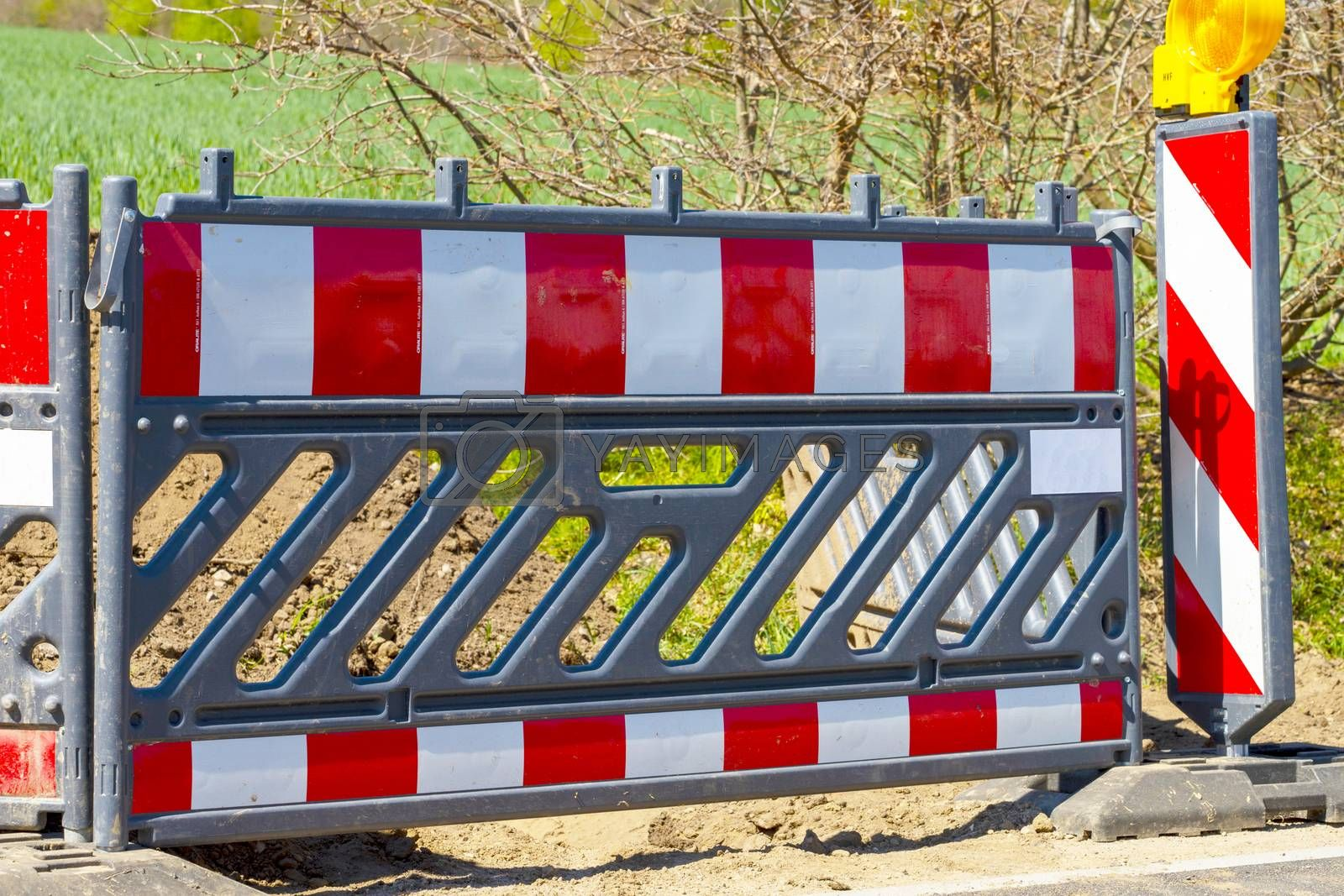 Royalty free image of Roadworks with construction site barriers by Fr@nk