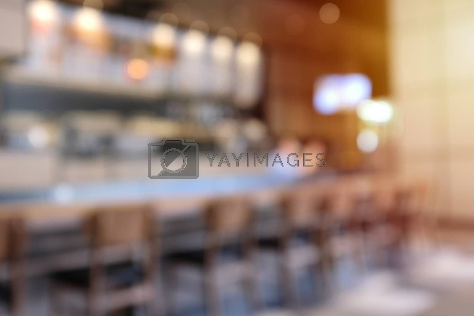 Abstract blur background of hipster cafe or restaurant interior with sunlight, for montage and mockup background
