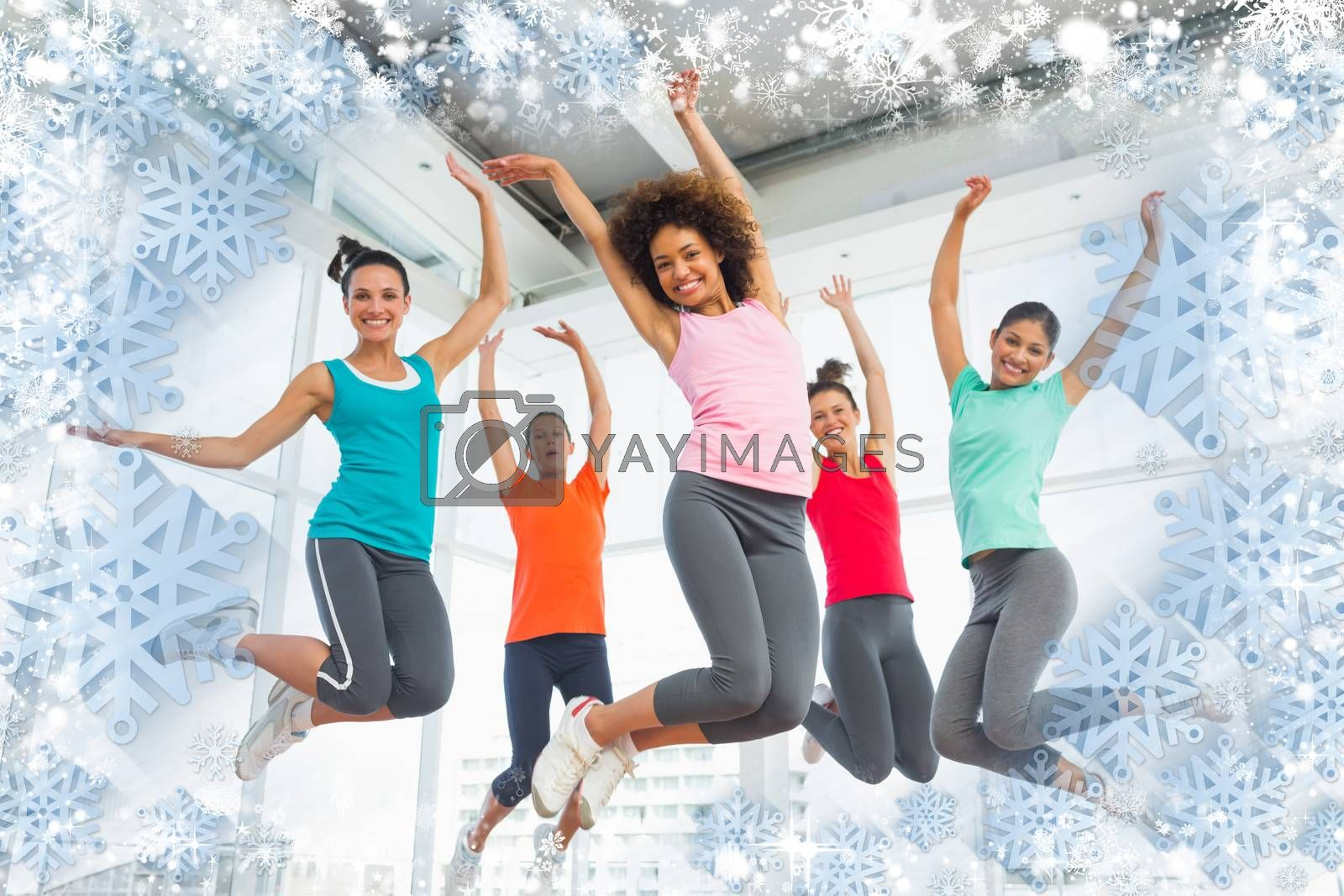Composite image of snow frame against fitness class and instructor jumping in fitness studio