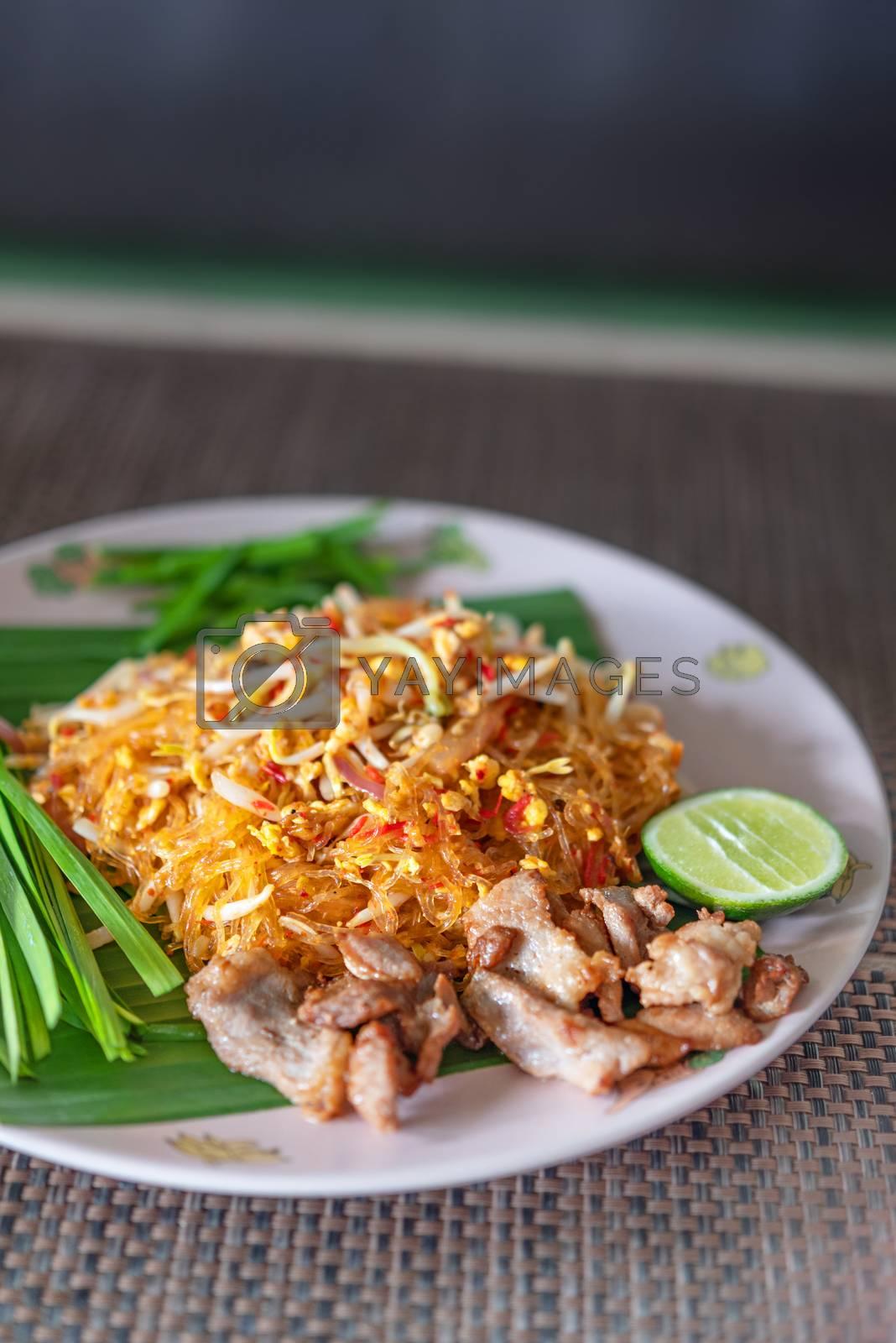 Royalty free image of stir fry noodles with pork by rakratchada