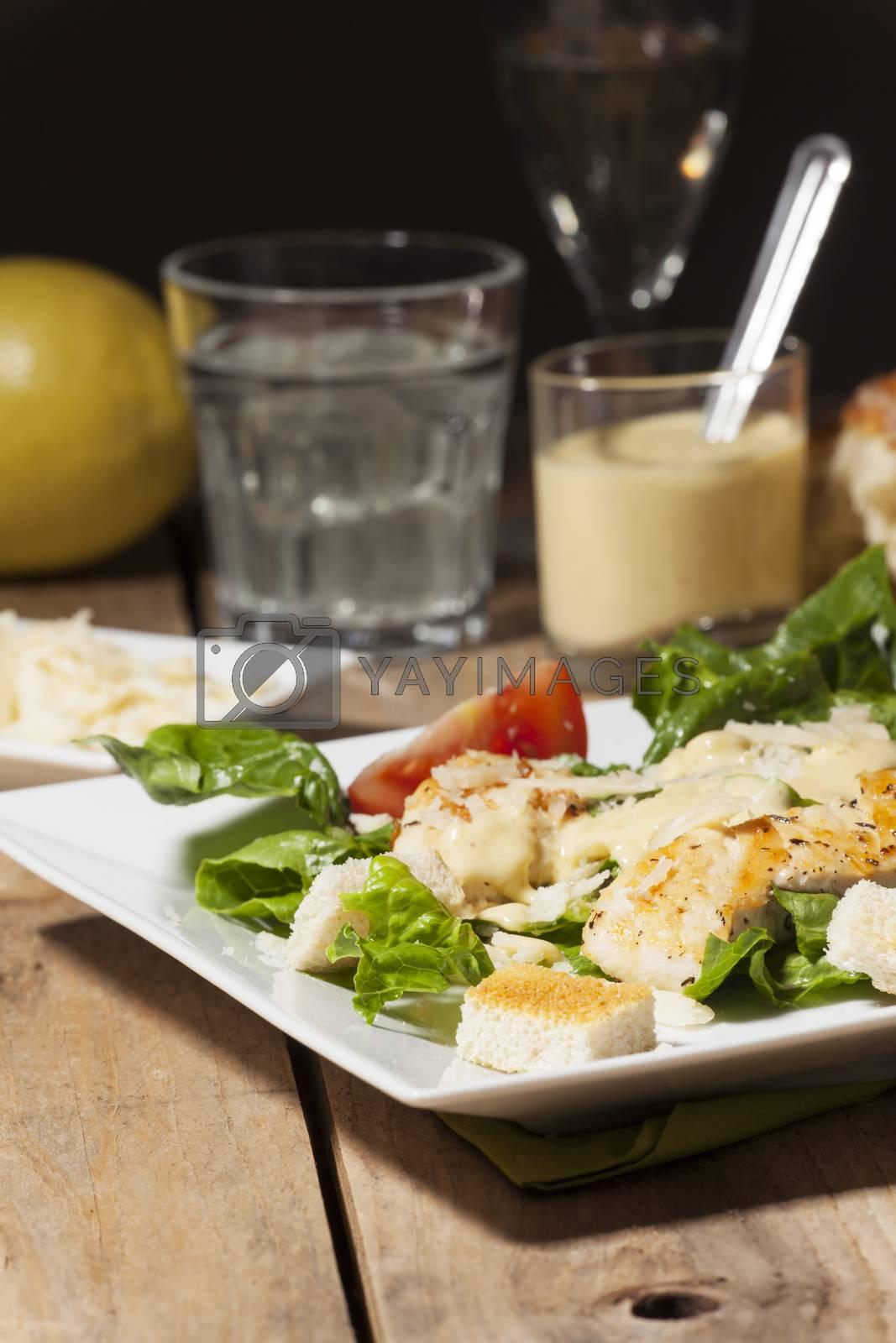 ceasar salad on rustic wood by bernjuer