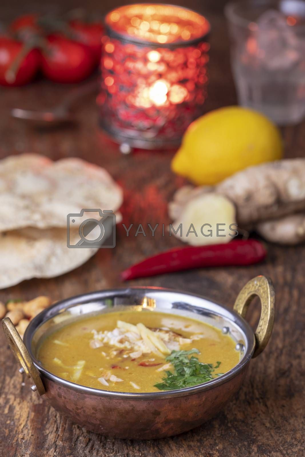 indian Mulligatawny soup in a brass bowl by bernjuer