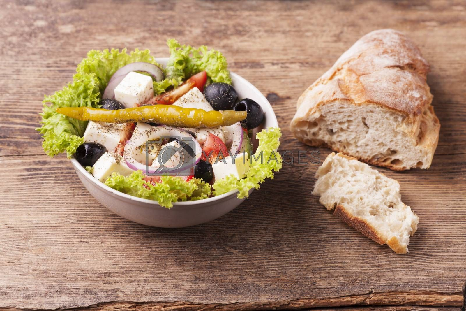 fresh greek salad with olives by bernjuer