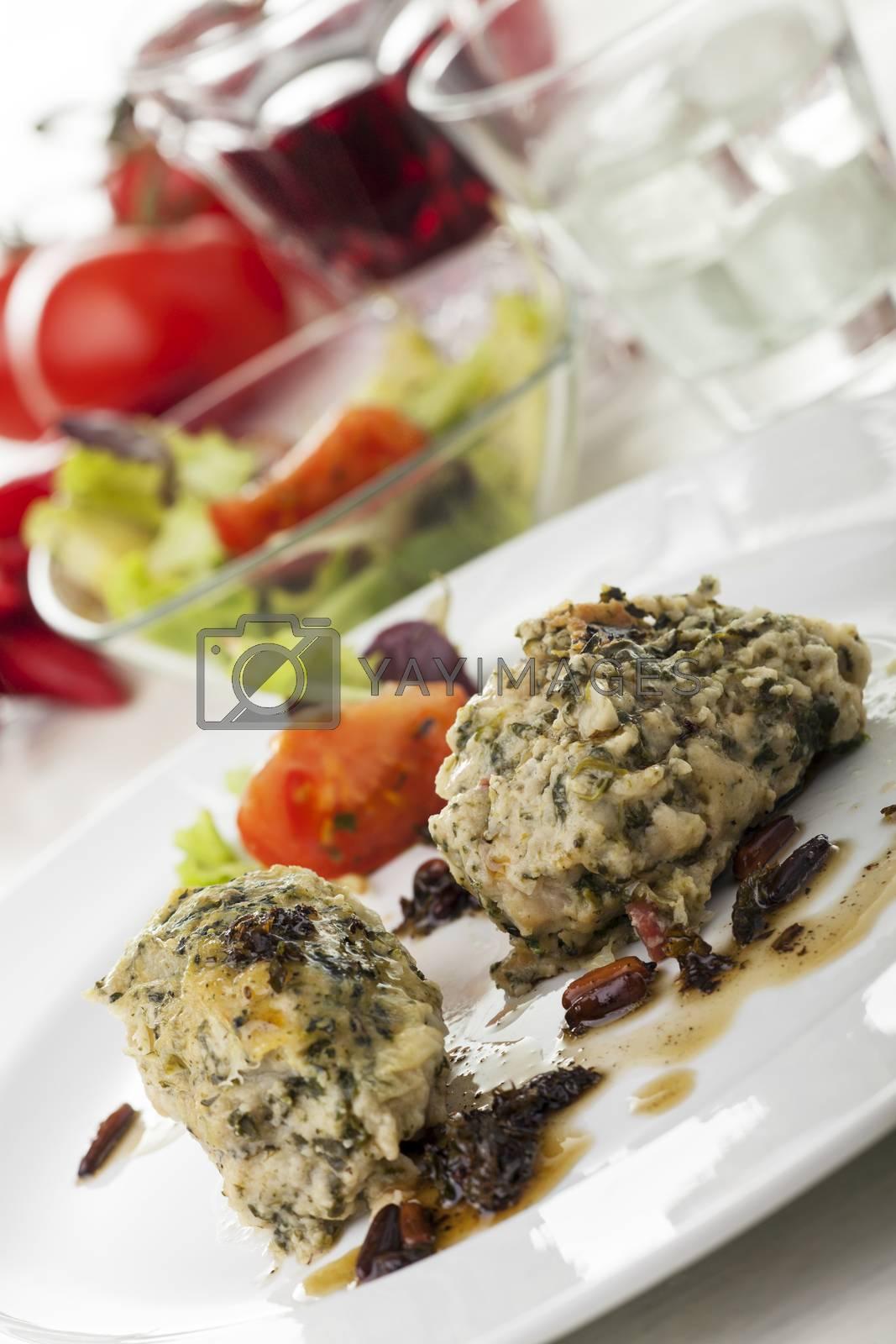 italian strangolapreti dumplings on a plate by bernjuer