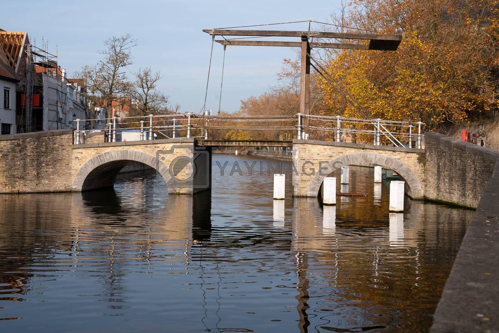 Old bridge crossing the canals of Bruges, Belgium