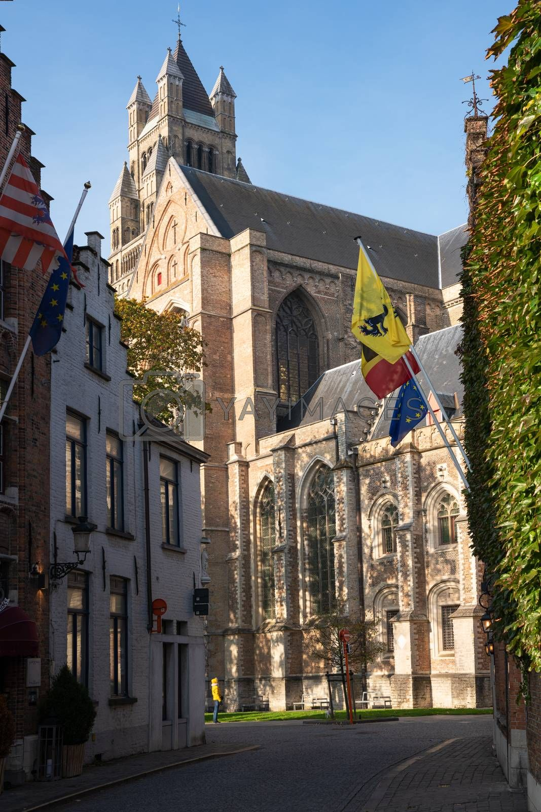 Street onto the cathedral, historic city of Bruges, Belgium