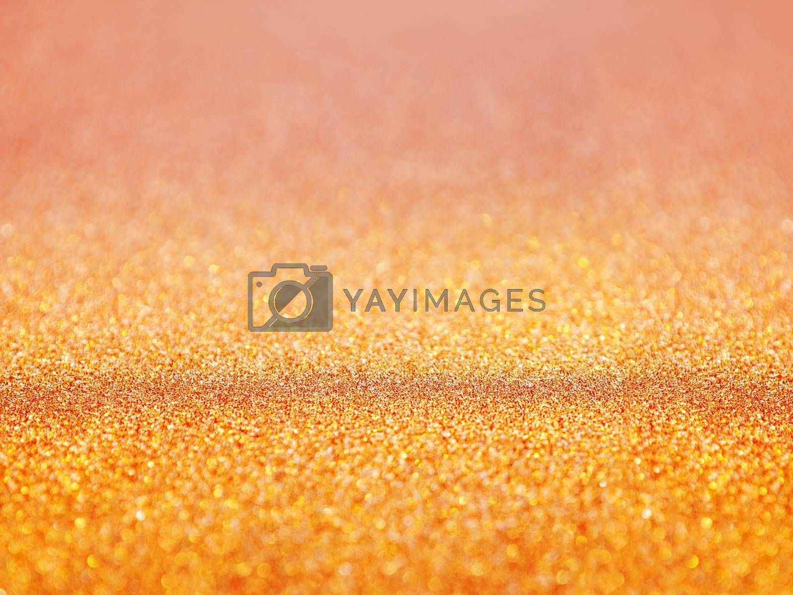Golden abstract background with shiny glitter. Orange festive sparkling macro texture. Holiday backdrop with copy space.