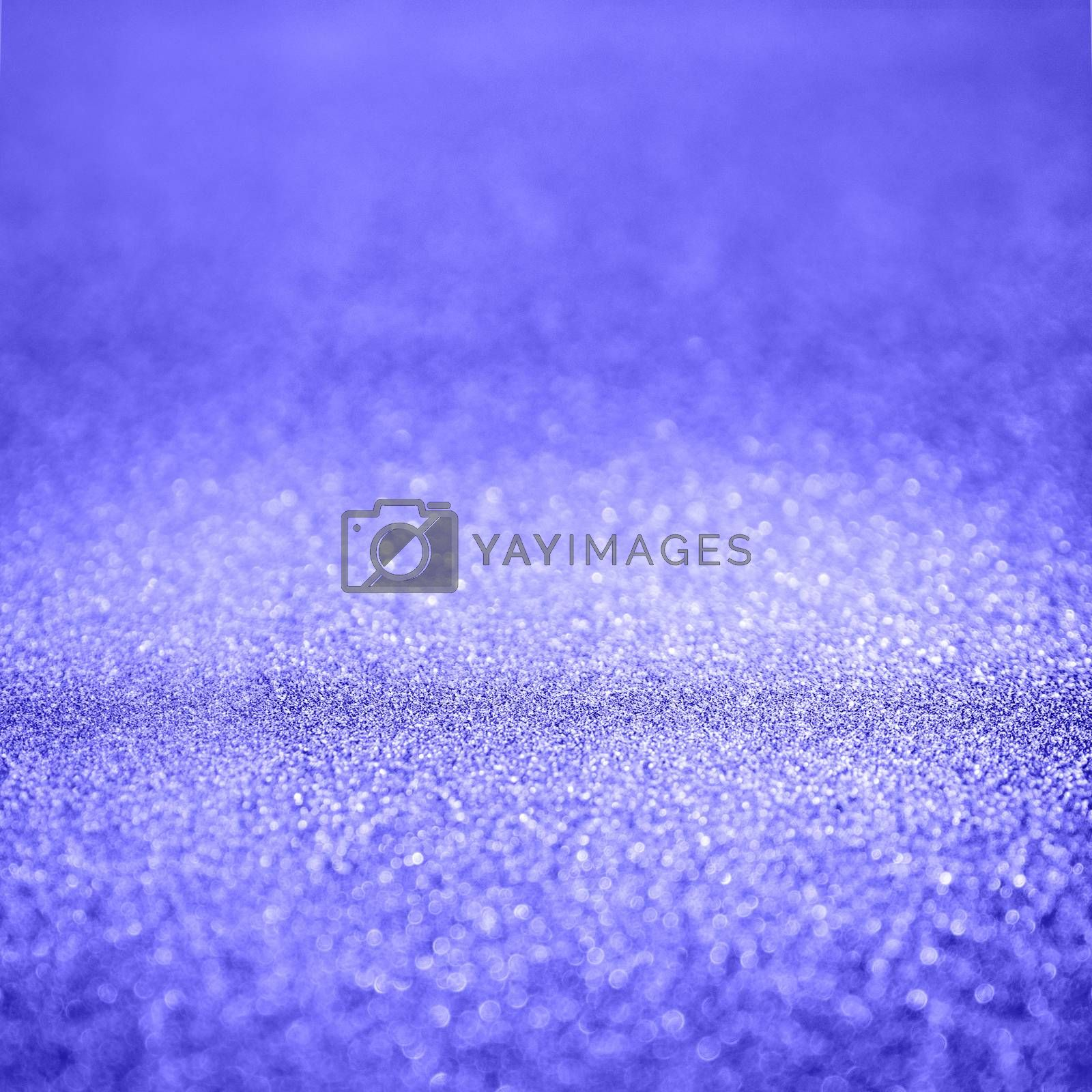 Violet abstract background with shiny glitter. Purple festive sparkling macro texture. Holiday backdrop with copy space.
