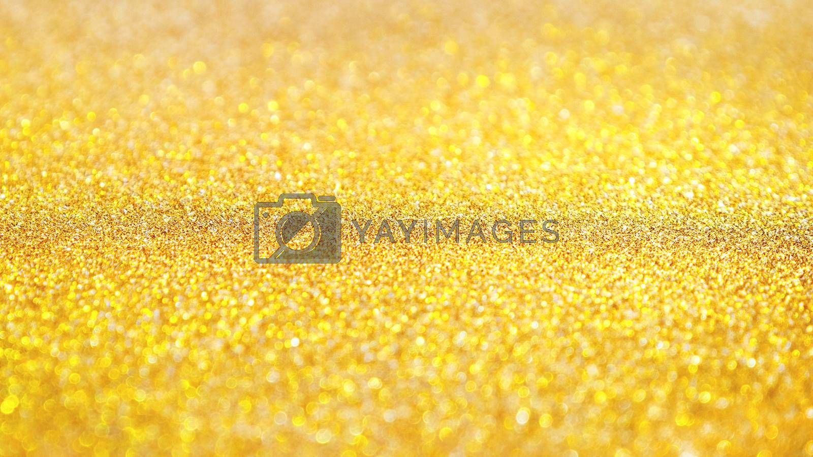 Yellow abstract background with shiny glitter. Golden festive sparkling macro texture. Holiday backdrop with copy space.