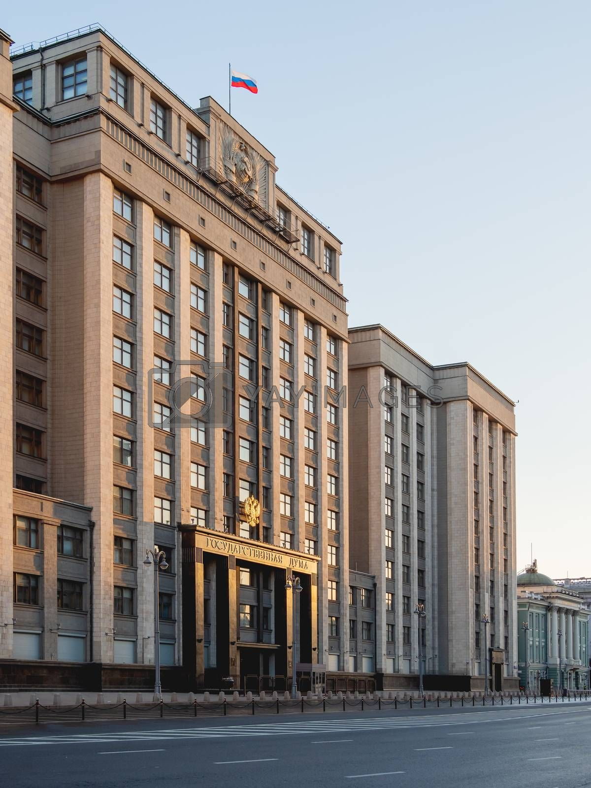 Building of State Duma of Russia inscribed - State Parliament . Deserted Okhotny Ryad street. Moscow, Russia.