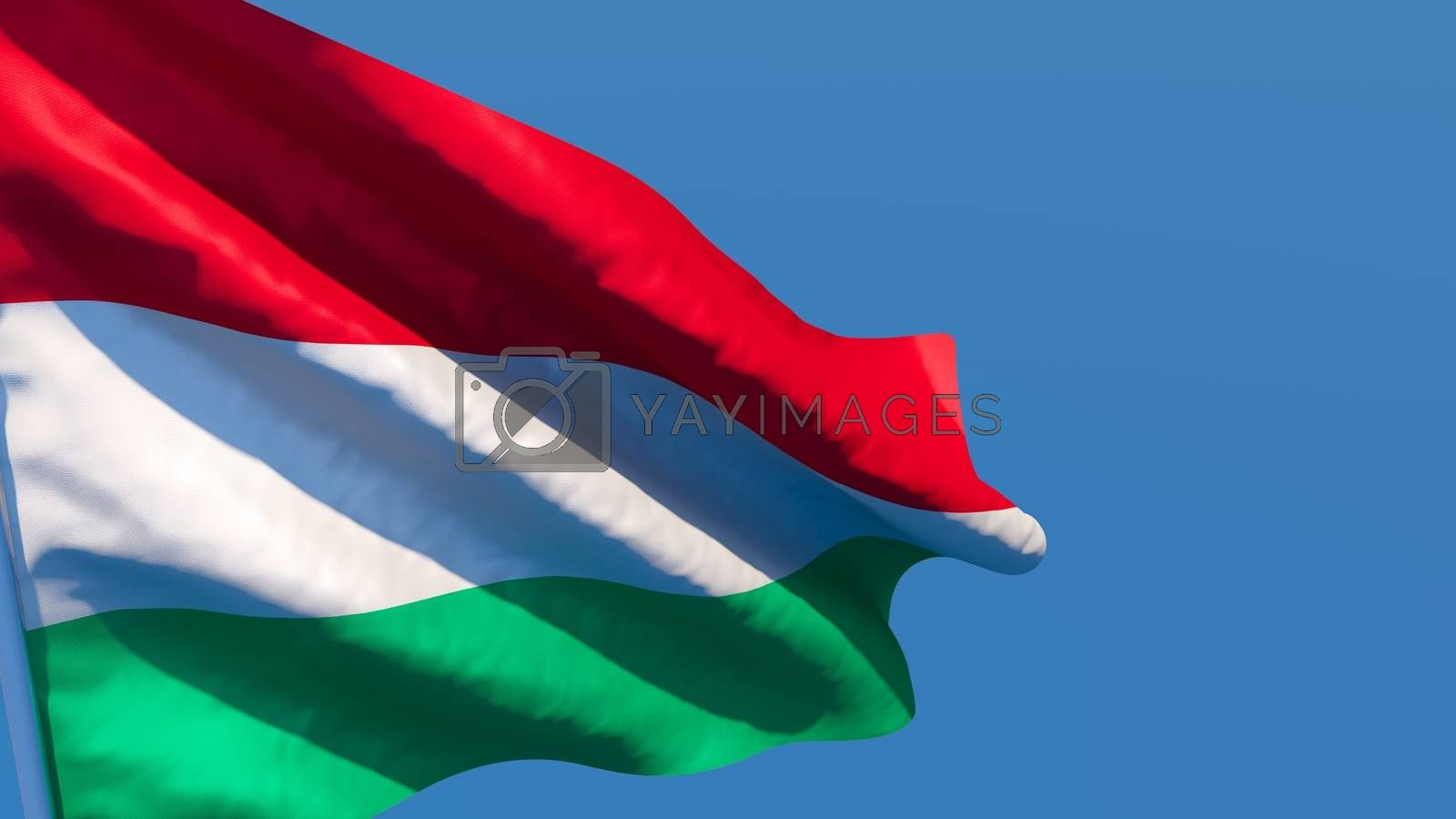 3D rendering of the national flag of Hungary waving in the wind against a blue sky.