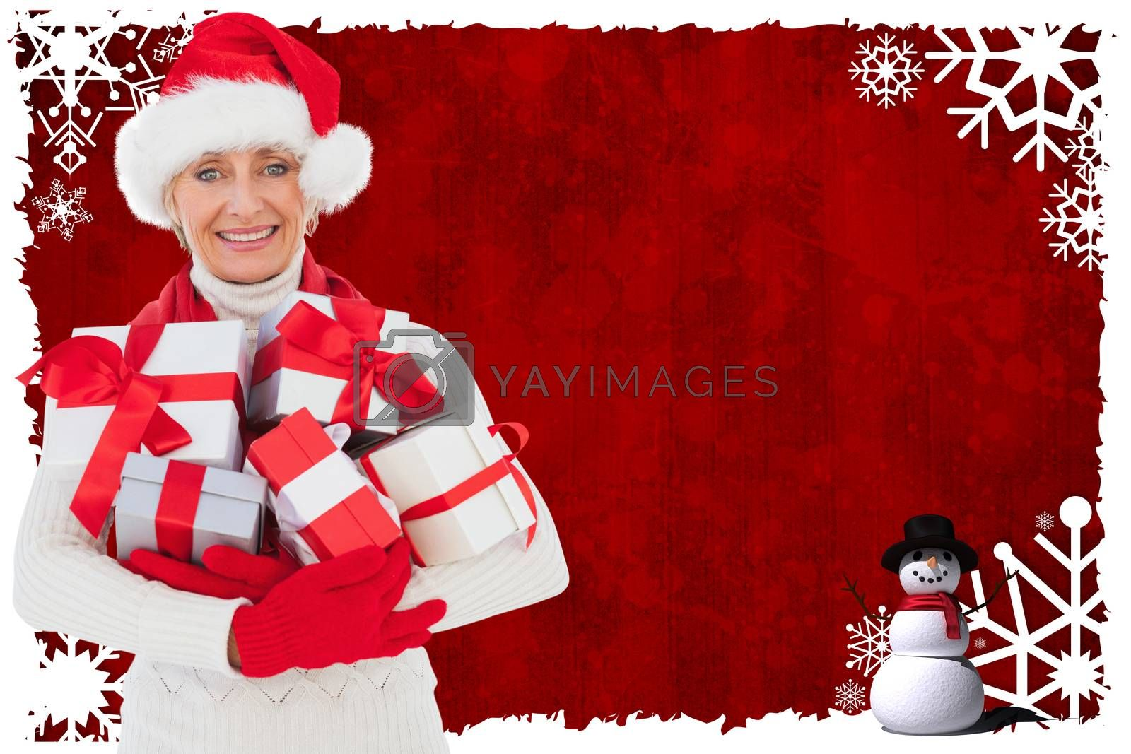 Festive woman holding gifts against christmas themed snow flake frame