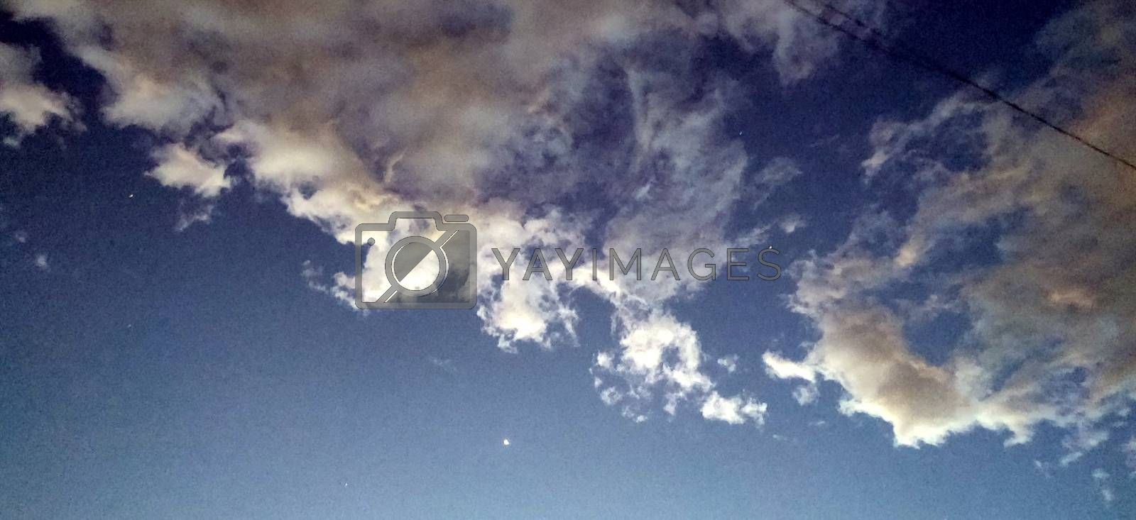 Royalty free image of The twilight sky and the reddish clouds by mshivangi92
