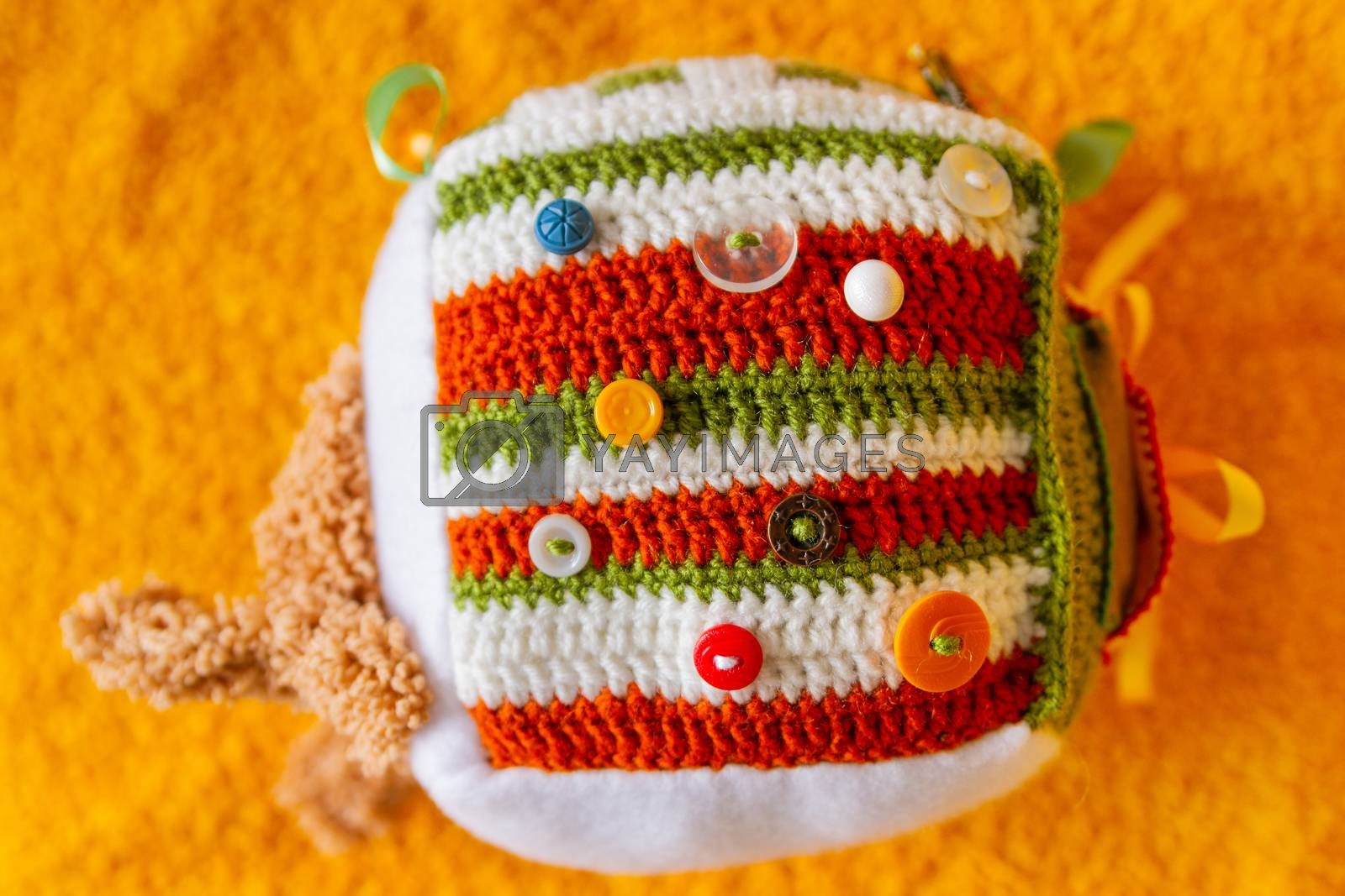 Colorful hand made toy for toddlers and babies. Busy cube. Soft baby block made of fabric to develop skills and fine motor skills. Taggie Cube. Montessori busy toy.