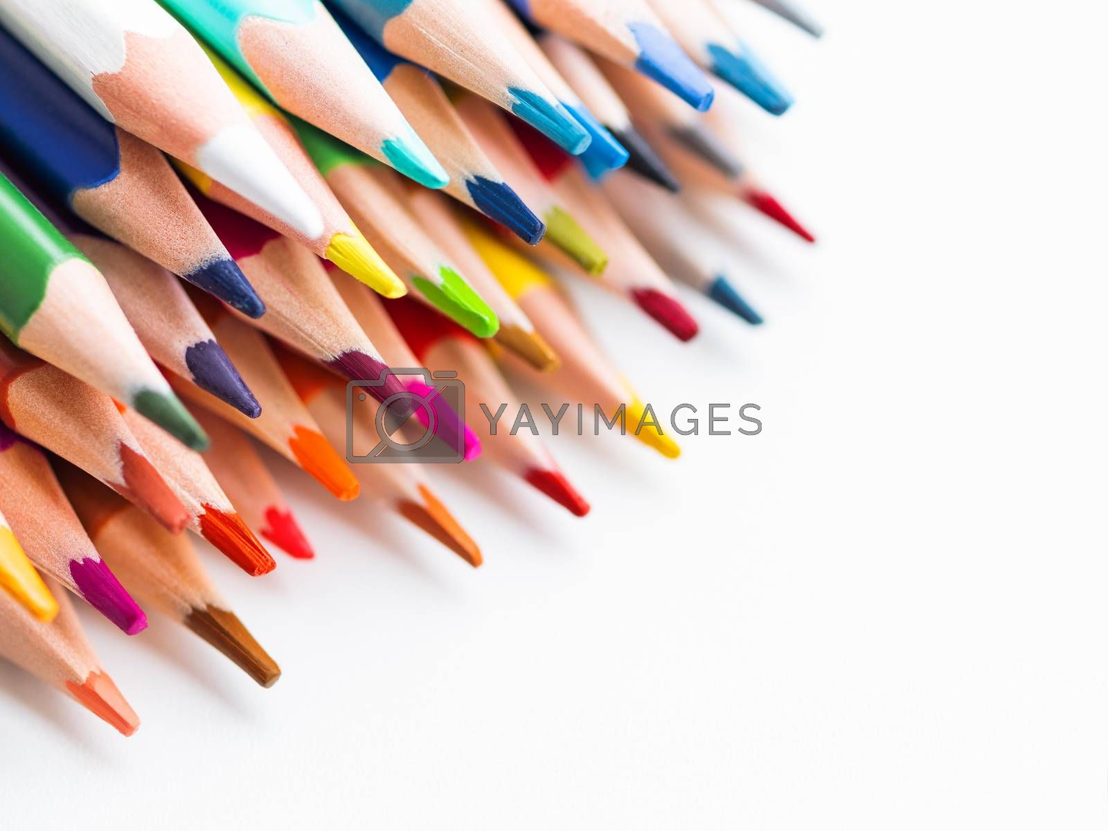 Row of colorful watercolor pencils on white background. School supplies. Kid's stationery with copy space. Back to school backdrop.