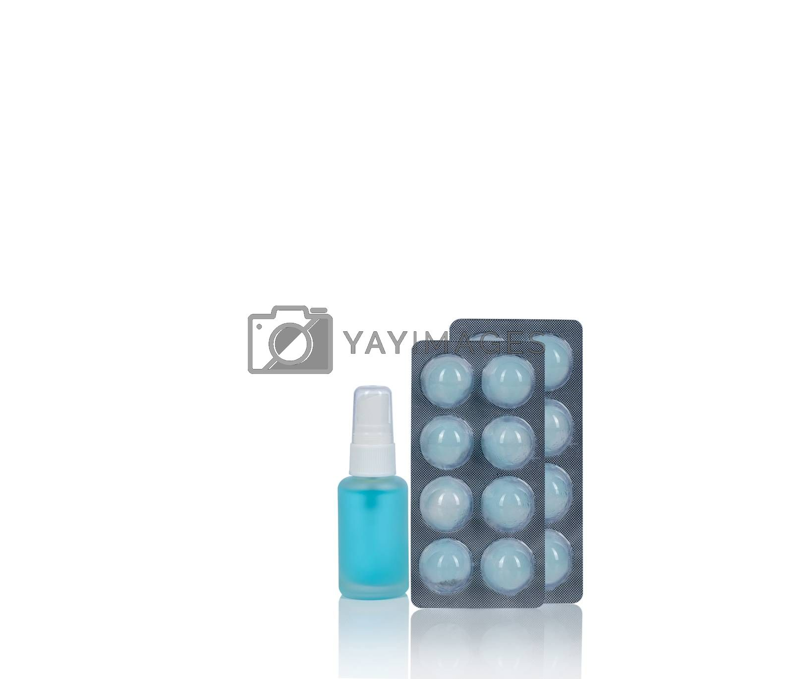 Alcohol spray in glass bottle container isolated on white background. Cotton ball with alcohol in blister pack for cleaning hand to protect coronavirus, germs. Medical supply for personal hygiene.