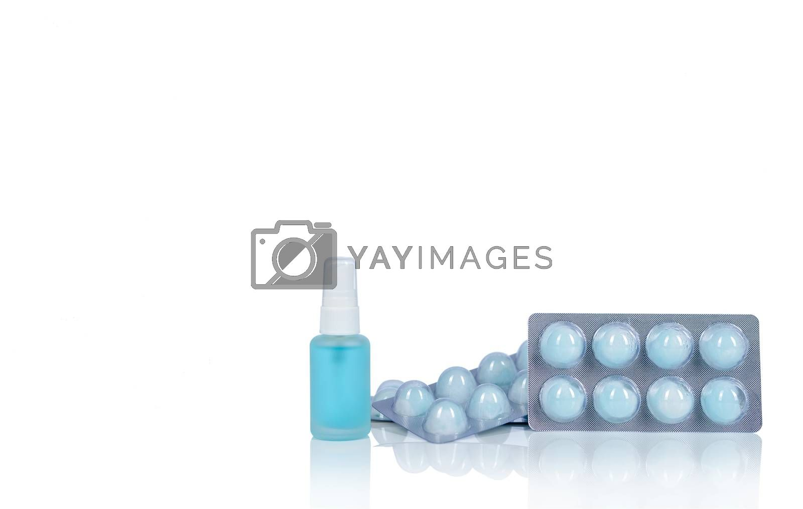 Alcohol spray in glass bottle container, Hand sanitizer in plastic tube, and cotton ball with alcohol in blister pack for cleaning hand to protect coronavirus. Medical supply for personal hygiene.