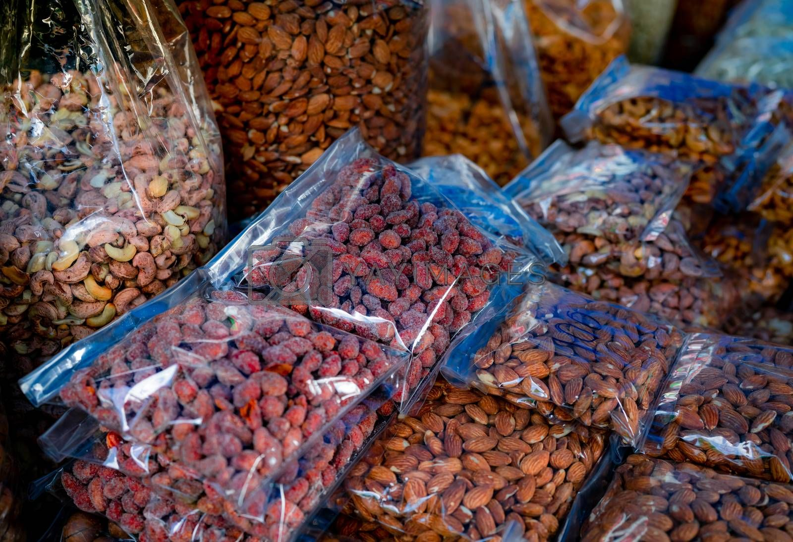 Almonds and cashew nuts in plastic bag at the market. Healthy food. High protein food for fitness or intermittent fasting people. Peeled seed. Healthy snack. Raw nuts for roasted. Vegan food in pack.