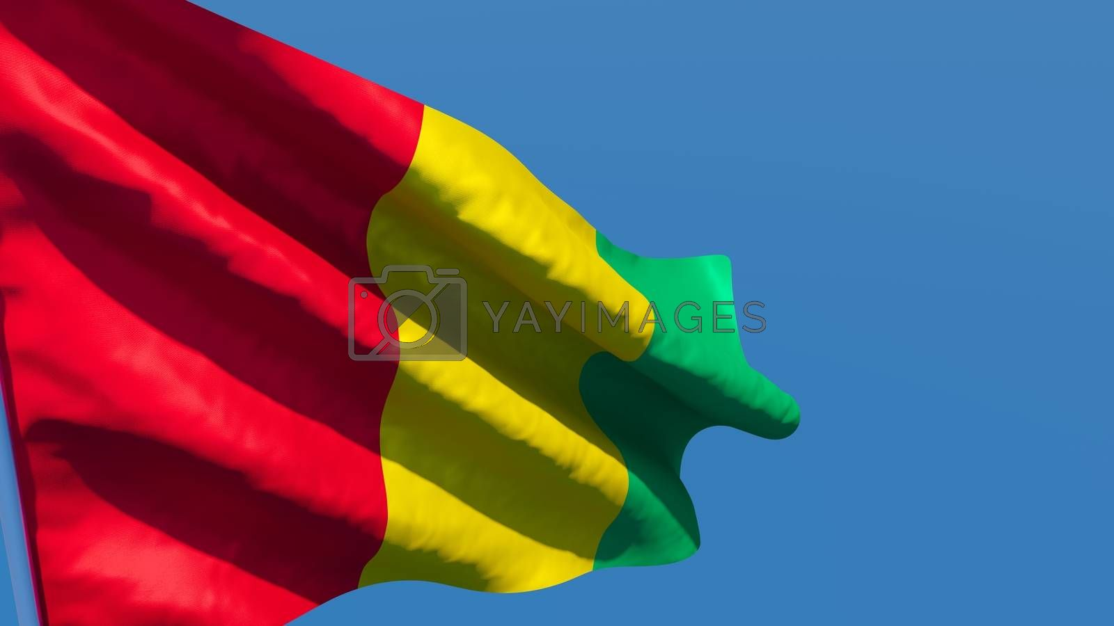 3D rendering of the national flag of Guinea waving in the wind against a blue sky
