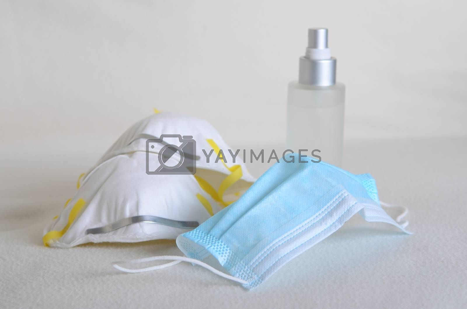 Corona virus covid-19 face mask protection N95 and medical surgical masks with sanitiser at home .