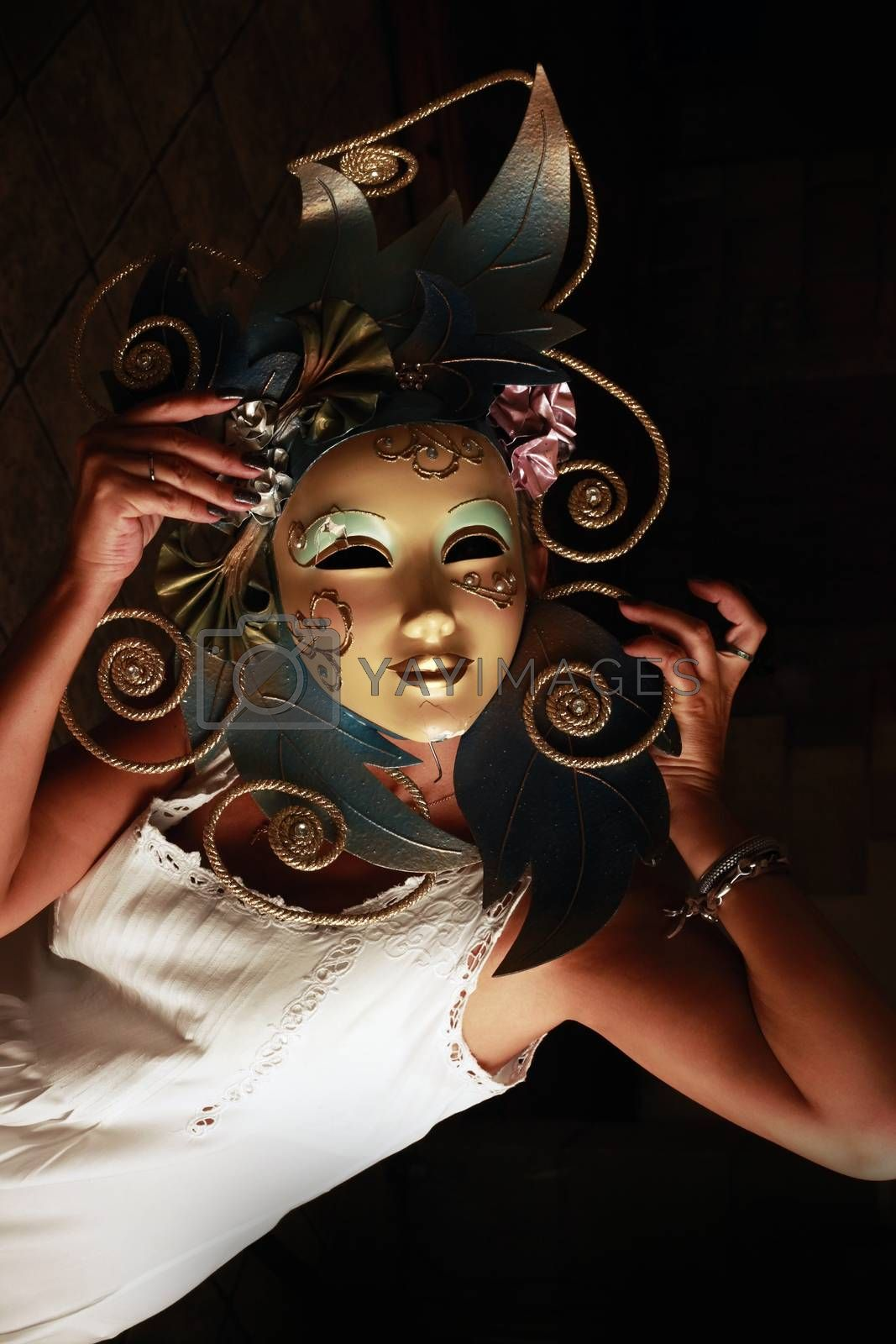 girl in a venetian mask on a dark background