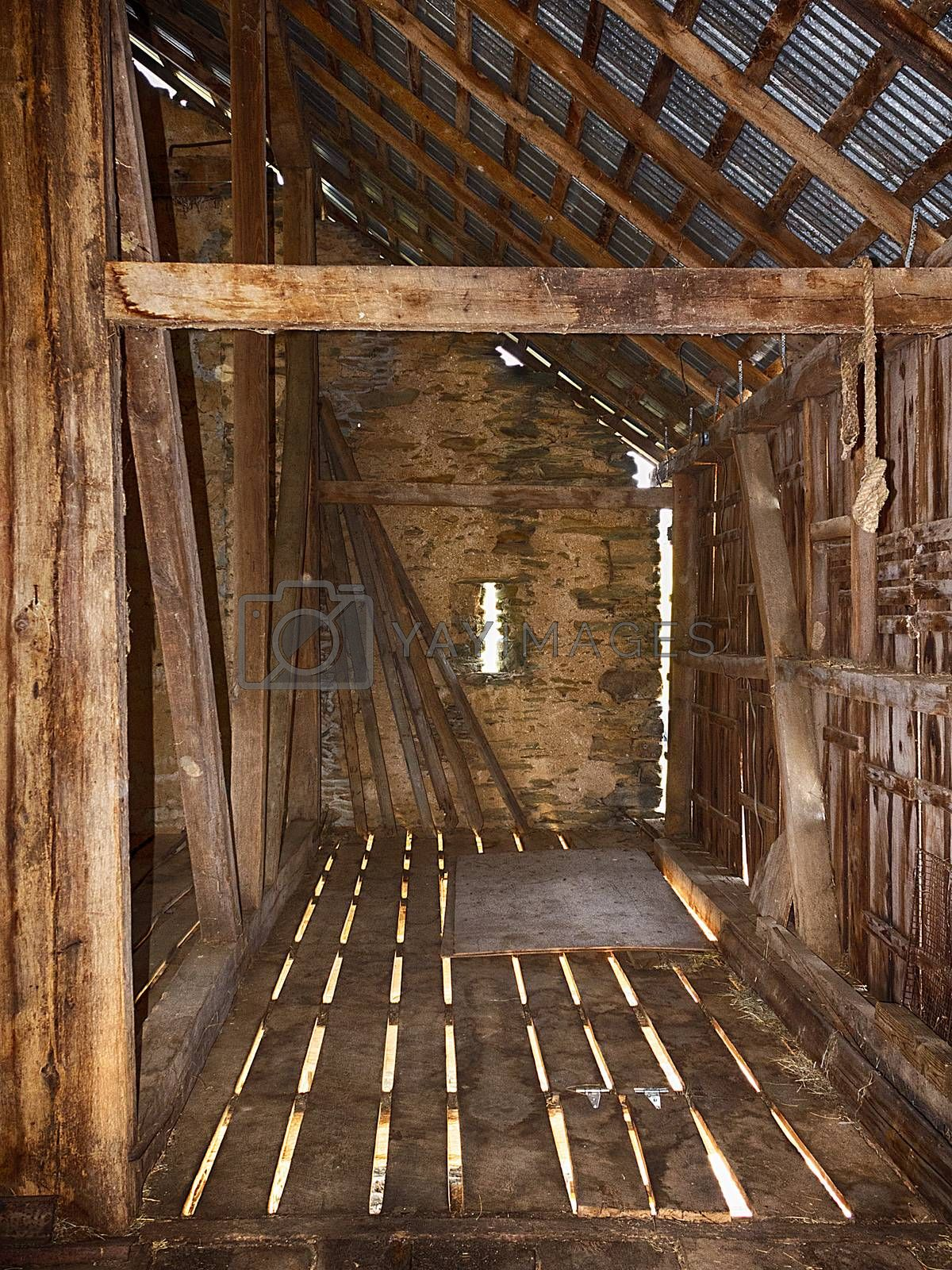 Interior view of old bank barn with stone walls