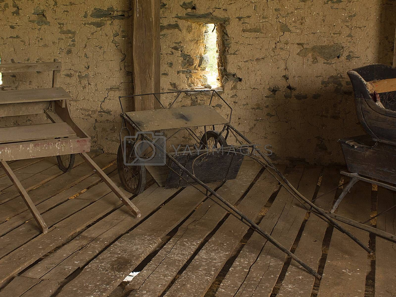 Horse racing sulky sitting in old stone bank  barn