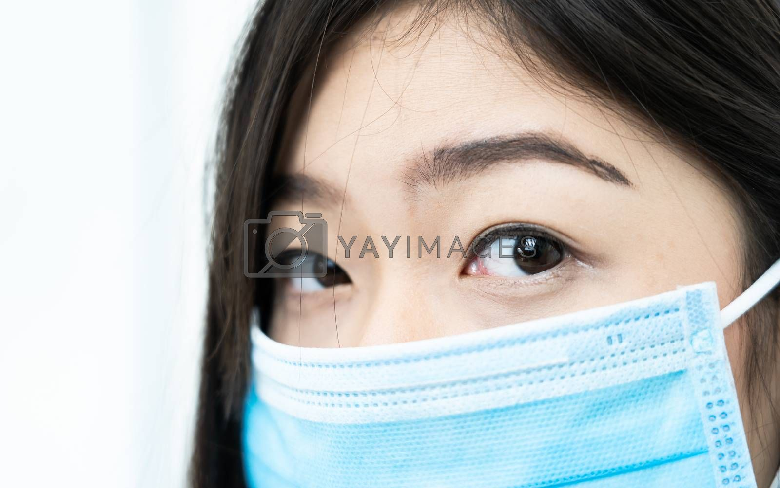 Close up woman with headache wearing mask for protect Covid-19 by stoonn