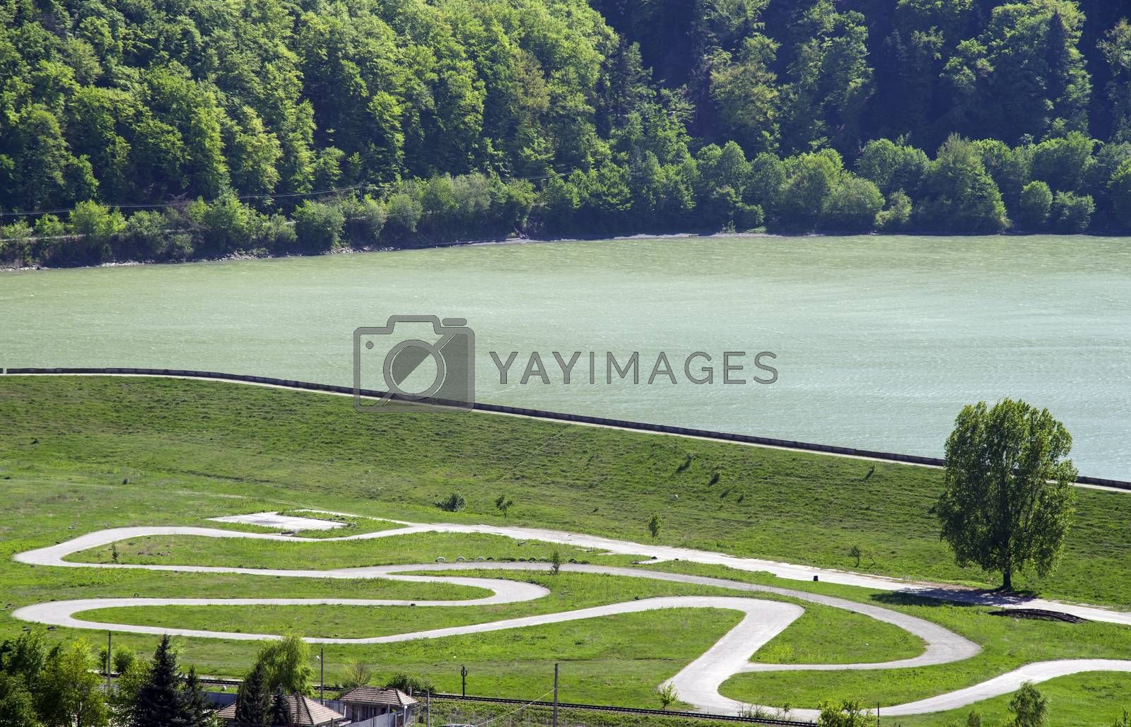 Karting race circuit near lake, aerial view