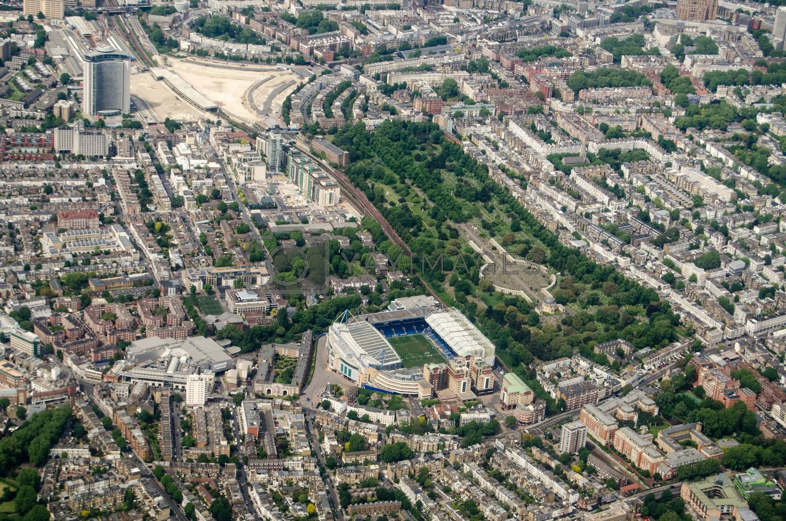 Aerial view looking north across Chelsea and Earls Court with the Stamford Bridge Stadium - home to Chelsea Football Club and Brompton Cemetary in the middle.  Top left is the Empress State Bilding and site of the former Earls Court exhibition halls.