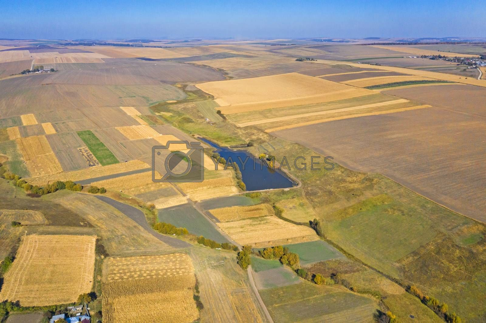 Aerial panorama of countryside area, autumn fields at harvest.