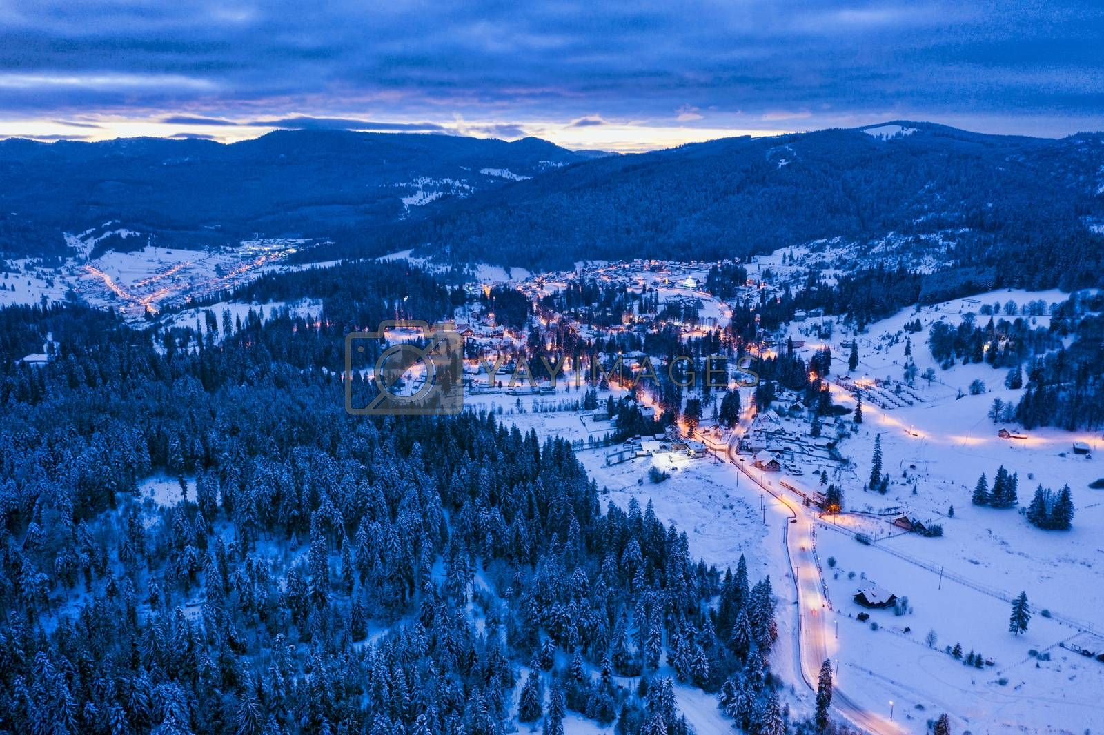 Aerial view of winter sports resort, Borsec lights at sunset.