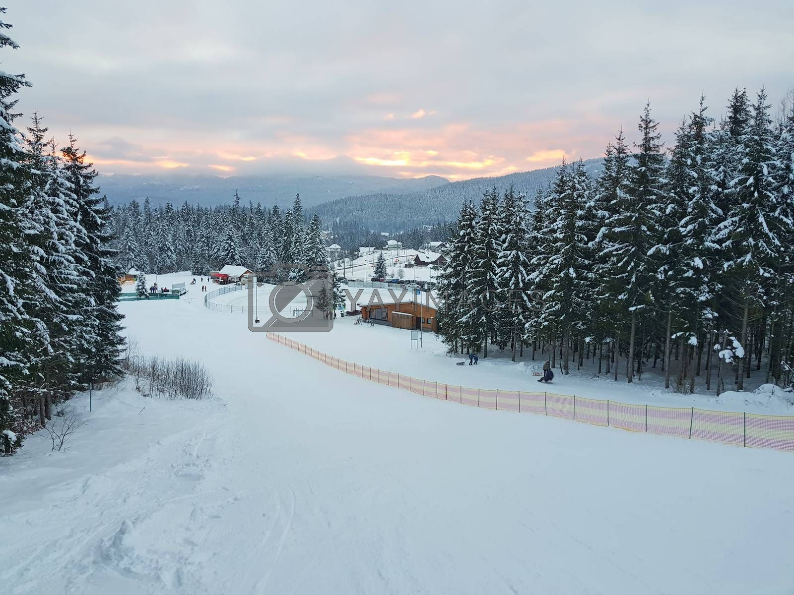 Ski and sled slope in winter resort, mountain winter landscape in Romanian Carpathians.
