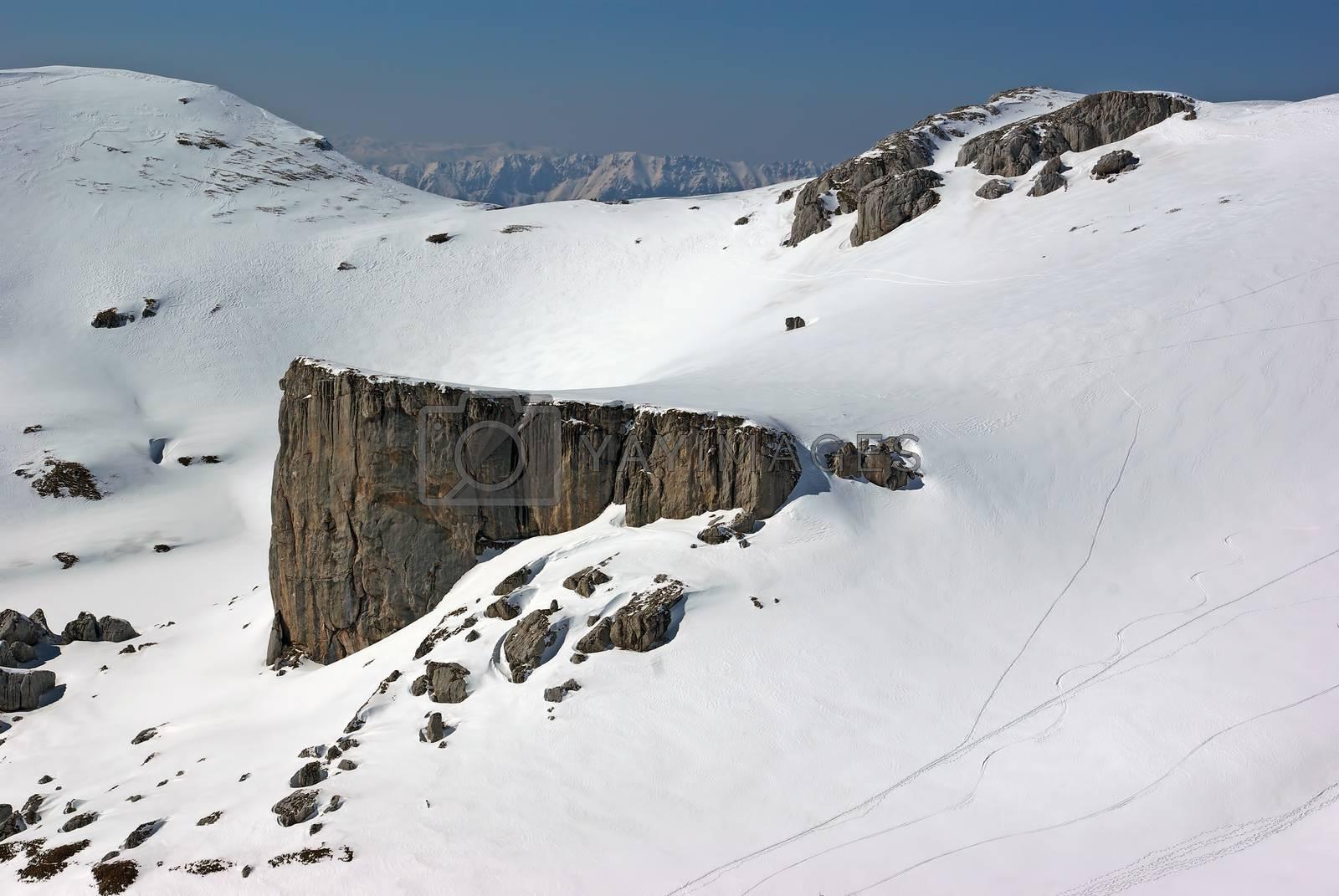 Winter mountain landscape, rock mountain covered by snow in alpine area, Romanian Carpathians