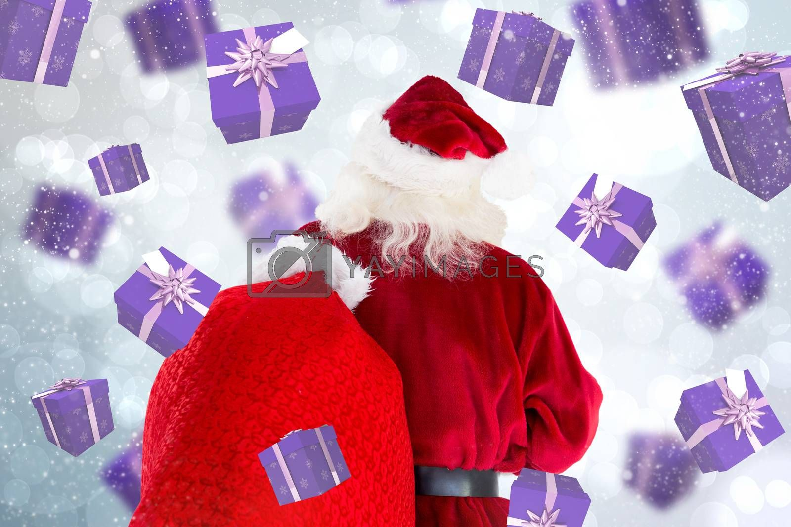 Santa claus carrying sack against light glowing dots design pattern