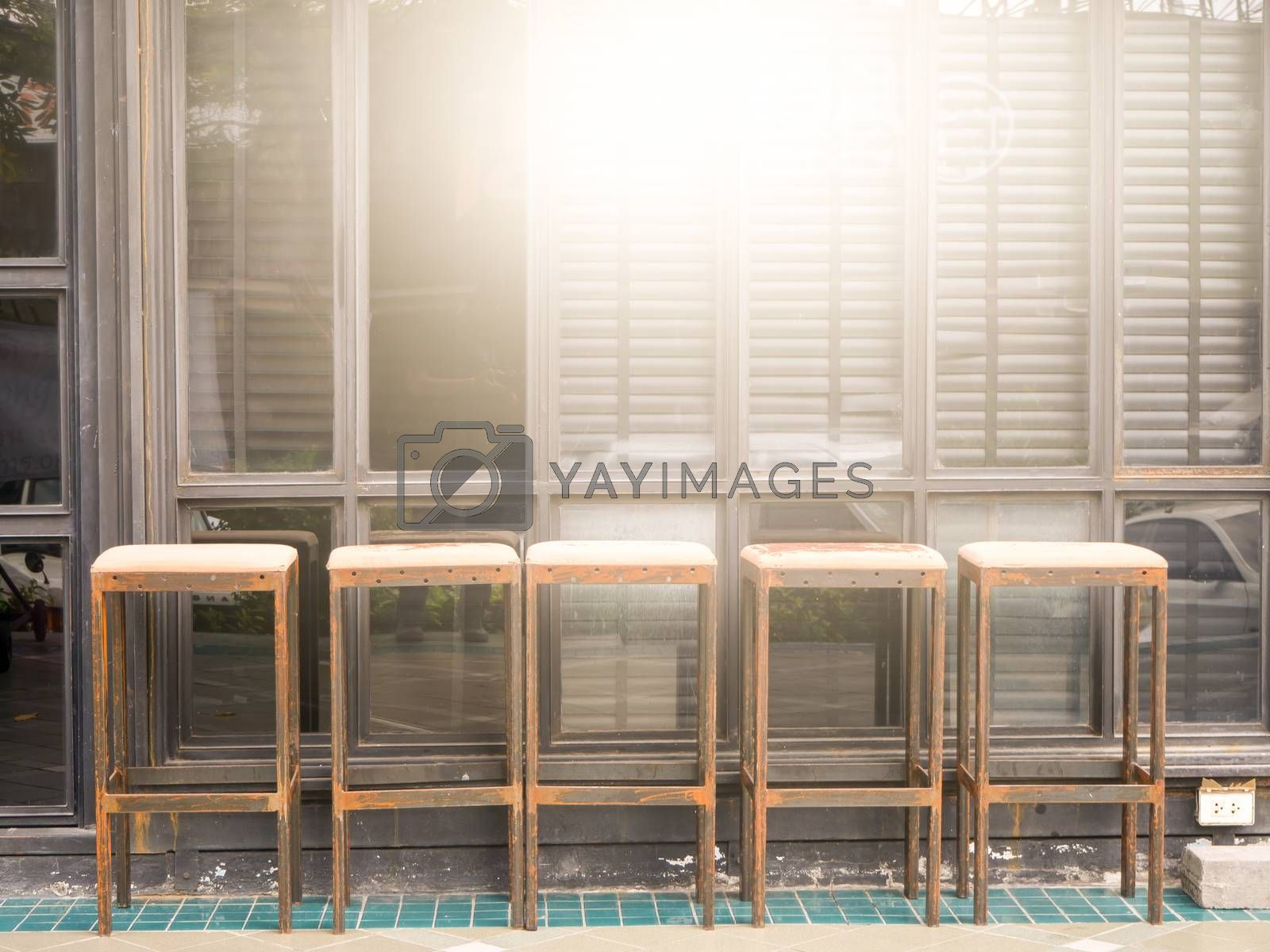 Royalty free image of Cafe with brick cafe and bar interior , row of chairs near glass by shutterbird